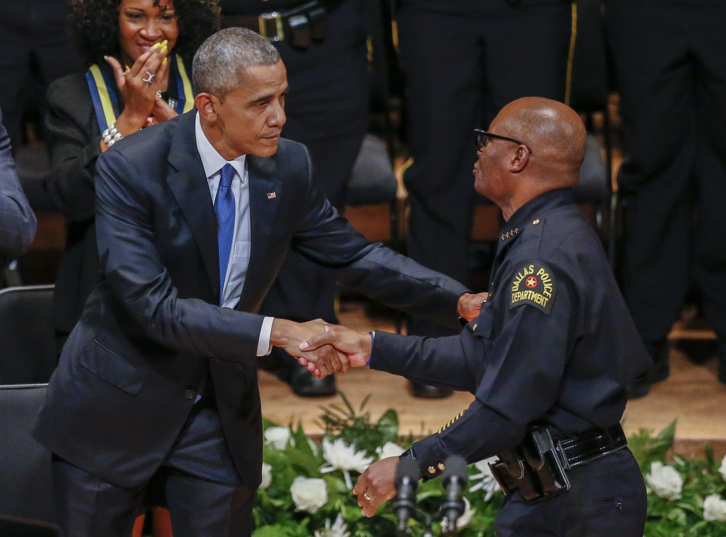 US President Barack Obama (L) is greeted by Dallas Police Department Chief David Brown (R) during the Interfaith Tribute to Dallas Fallen Officers at the Morton H. Meyerson Symphony Center in Dallas, Texas, USA, 12 July 2016. Five Dallas police officers died after an ambush assault by a gunman during a protest rally in Dallas on 07 July.