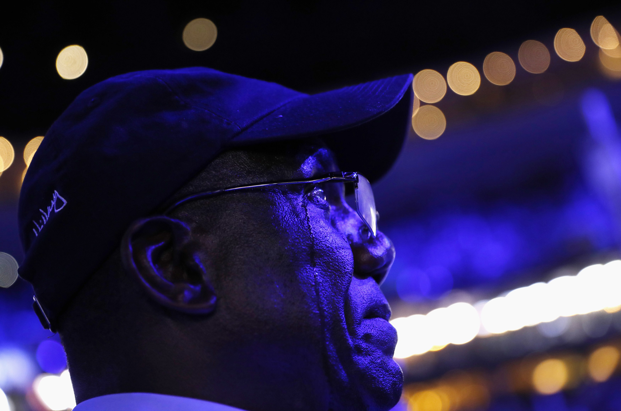 Tears stream down the face of a delegate as he listens to U.S. President Barack Obama speak on the third night at the Democratic National Convention in Philadelphia, Pennsylvania, U.S. July 27, 2016.