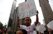 People take part in a protest for the killing of Alton Sterling and Philando Castile during a march along Manhattan's streets in New York