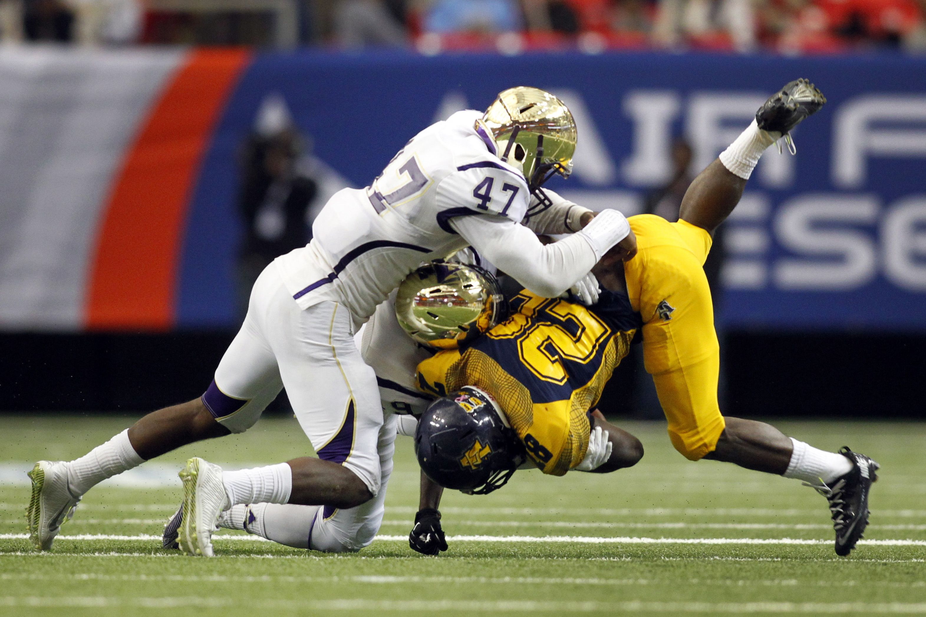 North Carolina A&T Aggies running back Tarik Cohen (28) is tackled by Alcorn State Braves linebacker Michael Hurns (47) and defensive back Anthony Williams Jr. (19) in the second quarter of the 2015 Celebration Bowl at the Georgia Dome.