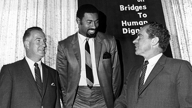 Wilt Chamberlain poses with United States president Richard Nixon with and Maryland governor Spiro T. Agnew during an event August 17, 1968 in Mission Bay, California.