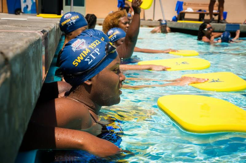 The women of Sigma Gamma Rho wade at the edge of the pool during a exclusive swim clinic during the Phillips 66 Swimming Nationals on August 9, 2014 at Northwood High School in Irvine, CA.