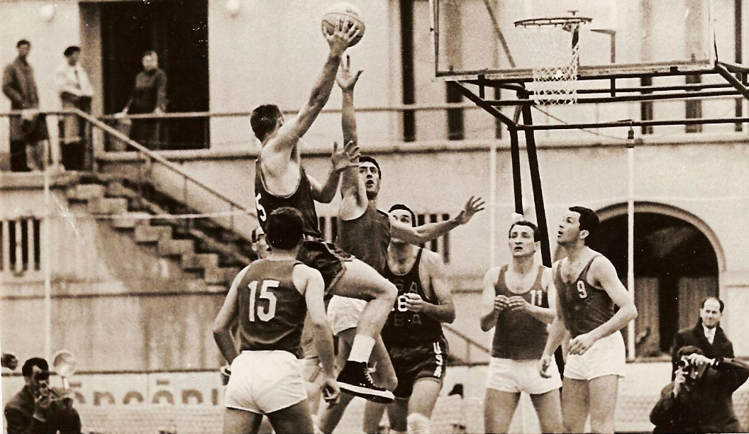 Tom Heinsohn shooting the hook shot, Jerry Lucas under the basket.