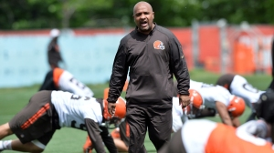 Cleveland Browns head coach Hue Jackson yells to the team during minicamp at the Cleveland Browns training facility.
