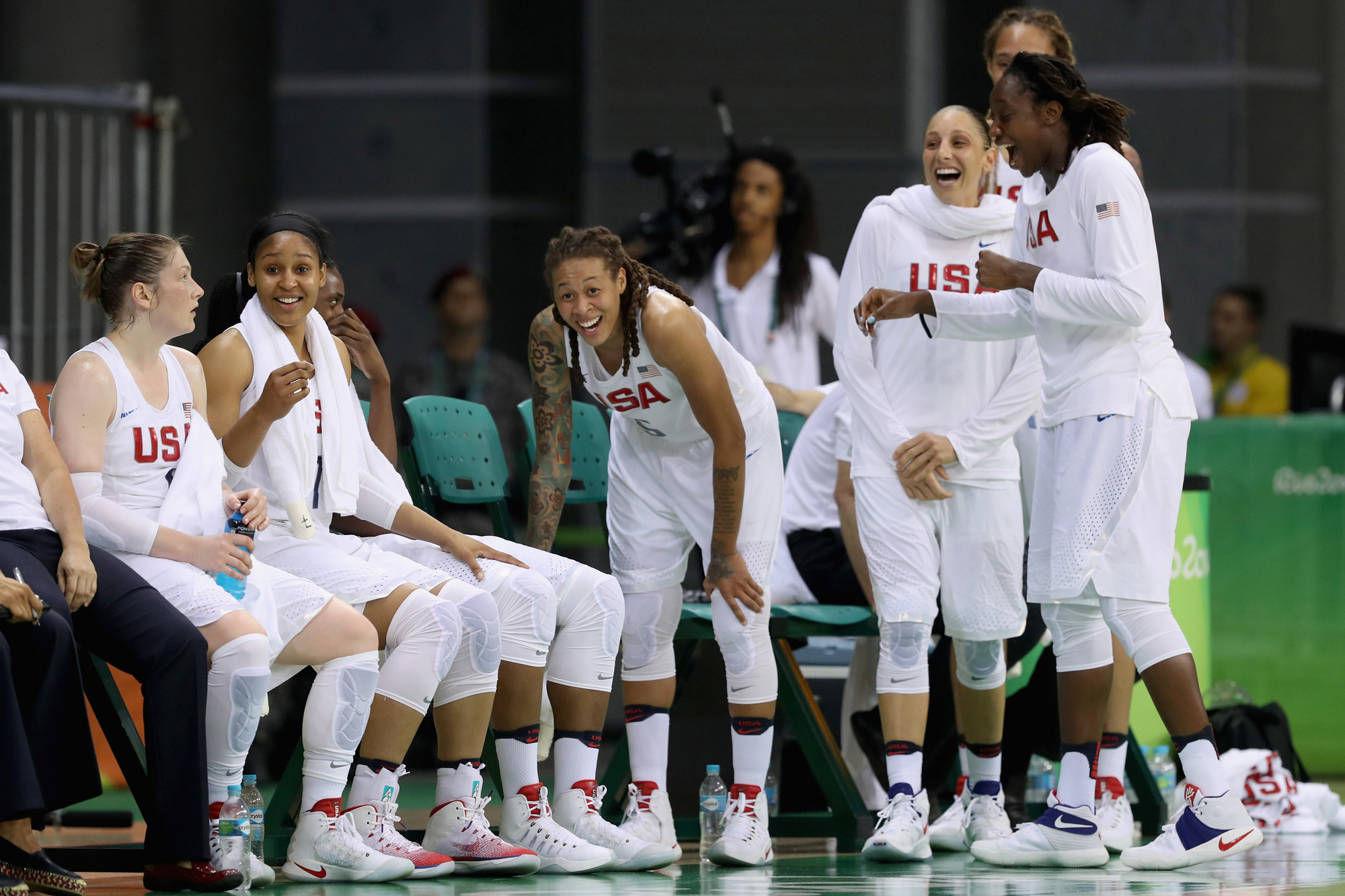 The United States bench laughs during the closing moments of their 110-84 win over Serbia in the Women's Basketball Preliminary Round Group B match between China and Spain on Day 5 of the Rio 2016 Olympic Games at Youth Arena on August 10, 2016 in Rio de Janeiro, Brazil.