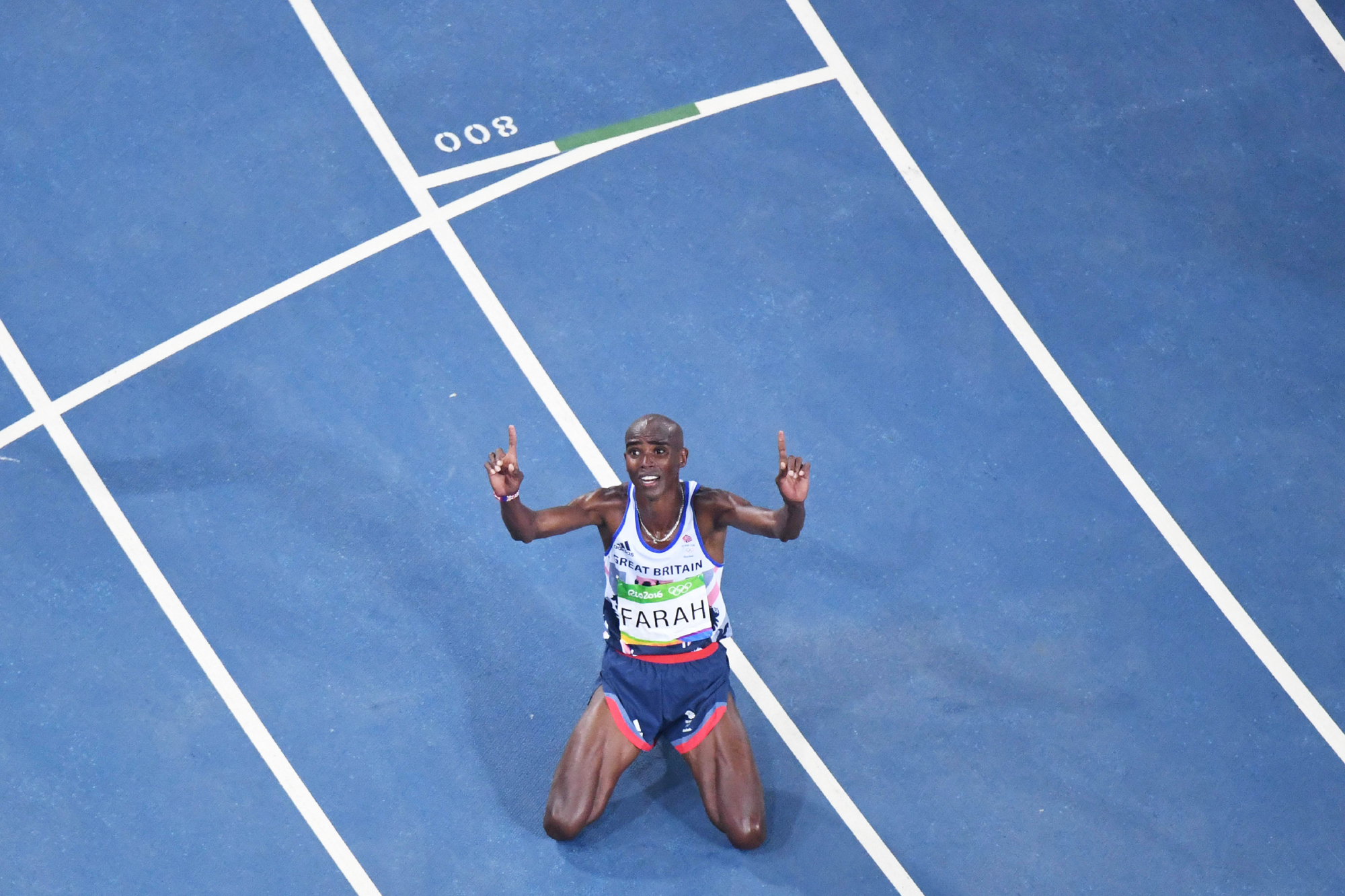 Britain's Mo Farah celebrates winning the Men's 10,000m during the athletics event at the Rio 2016 Olympic Games at the Olympic Stadium in Rio de Janeiro on August 13, 2016.