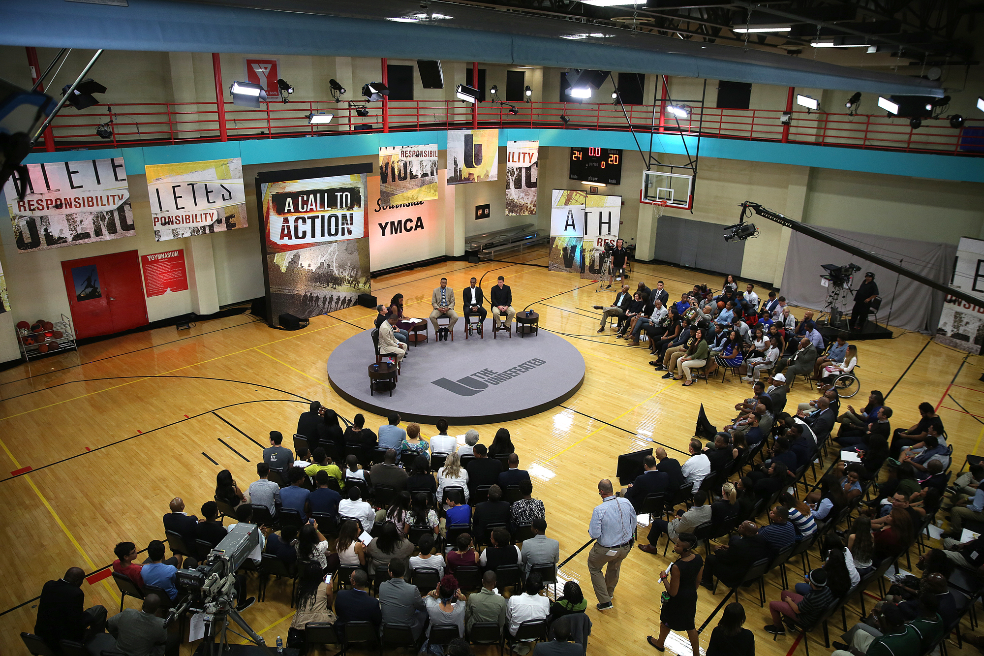 "The final panel during ""An Undefeated Conversation: Athletes, Responsibility, and Violence"" on August 25, 2016 at the South Side YMCA in Chicago, Illinois. Four panels made up of community members, athletes and journalist talked about the issues of gun violence, solutions and the roles that athletes have to help the solve the issues."
