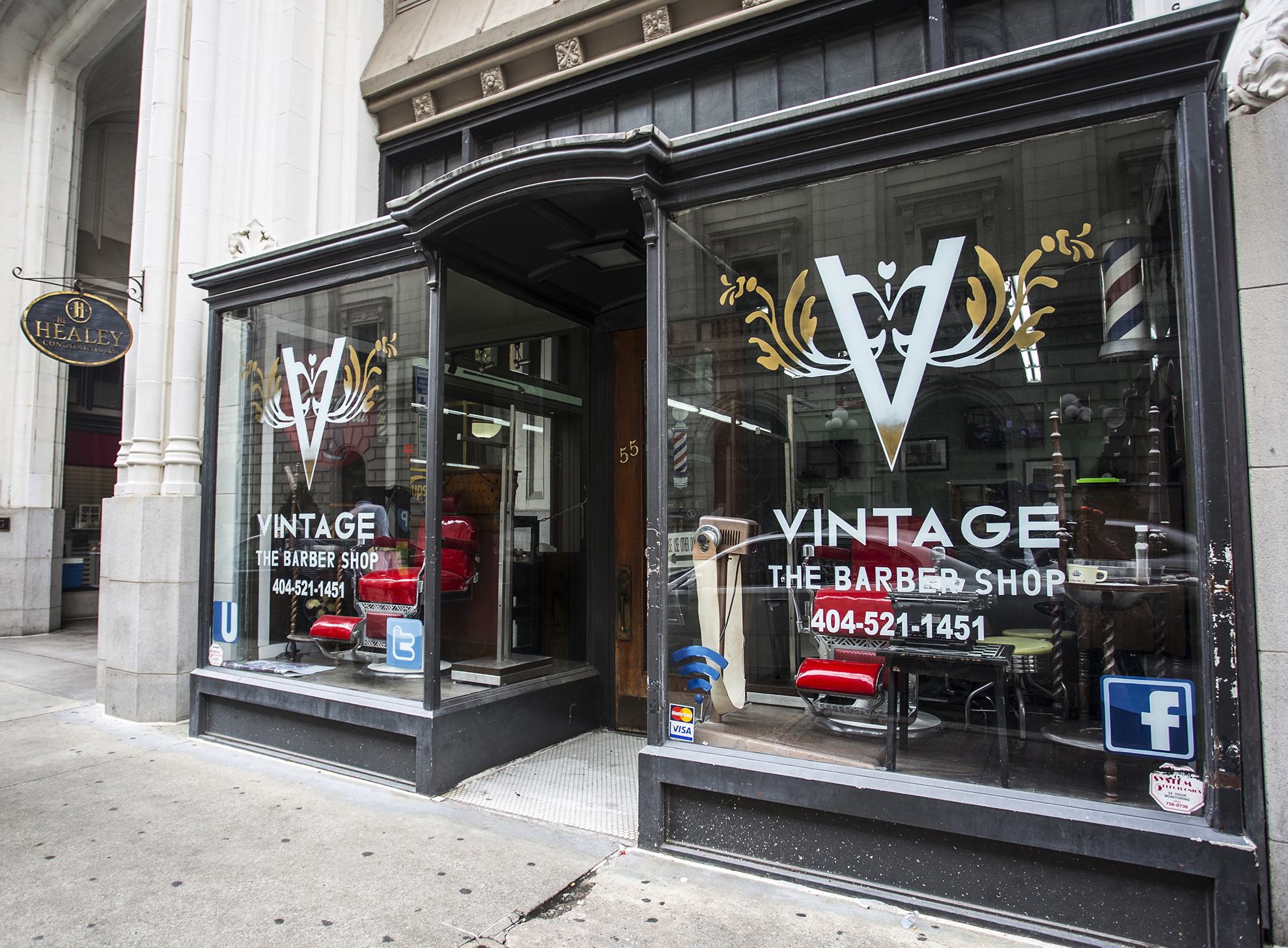 This photo shows the exterior of Vintage the Barber Shop on Tuesday, Aug. 9, 2016, in Atlanta. Swimmer Michael Phelps, of the United States, stopped by the shop before departing for the 2016 Summer Olympics in Rio de Janeiro, Brazil, and posted a selfie on his Instagram.