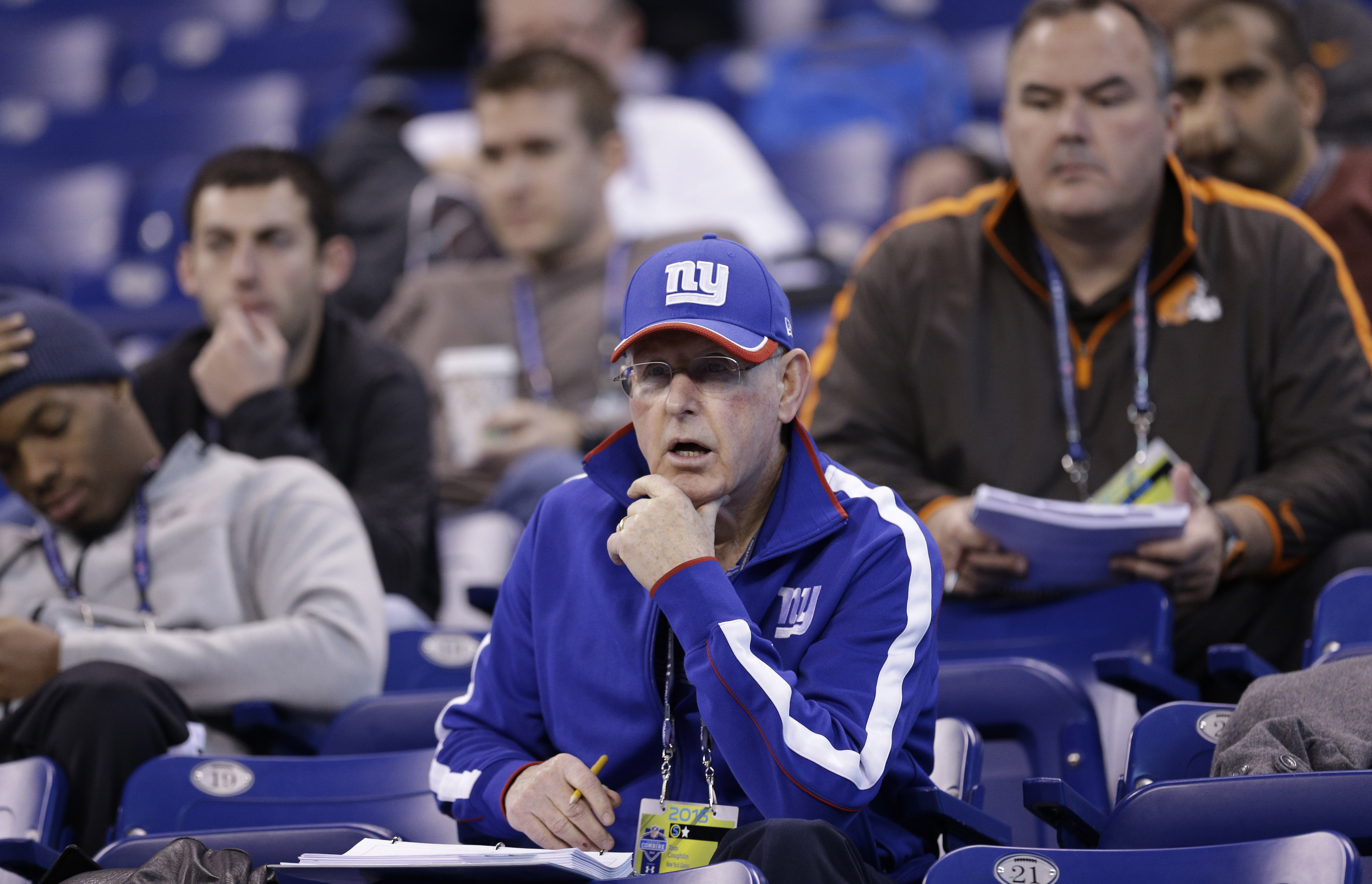 New York Giants coach Tom Coughlin watches quarterbacks and wide receivers run drills at the NFL football scouting combine in Indianapolis, Saturday, Feb. 21, 2015.