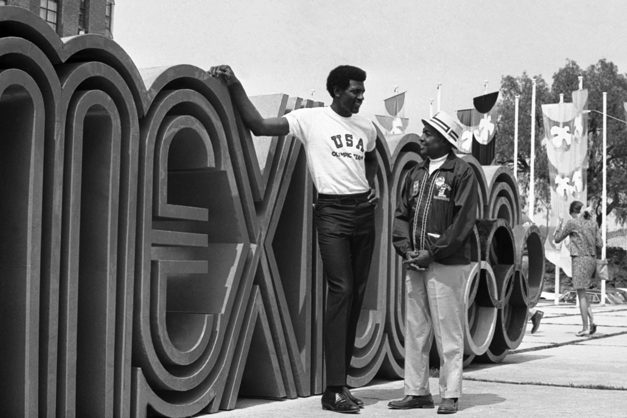 Spencer Haywood, member of the United States basketball team which has reached the finals in the Mexico City Olympic games, shows his father, Will Robinson, the sights in the Olympic Village in Mexico City Oct. 23, 1968. (AP Photo)