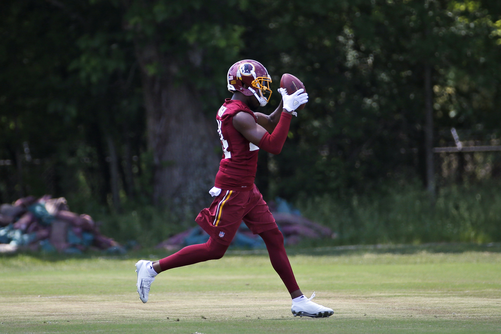 Washington Redskins corner back Josh Norman (24) catches the ball during practice at the team's NFL football training facility at Redskins Park, Wednesday, June 1, 2016 in Ashburn, Va.