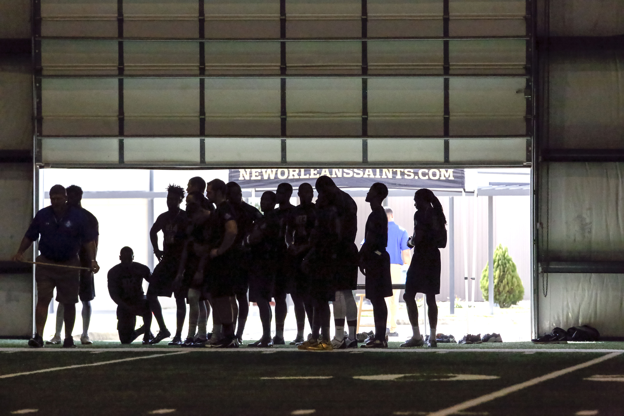 Tight ends and receivers await their next drill during the NFL football regional combine at the New Orleans Saints training facility in Metairie, La., Sunday, March 13, 2016.