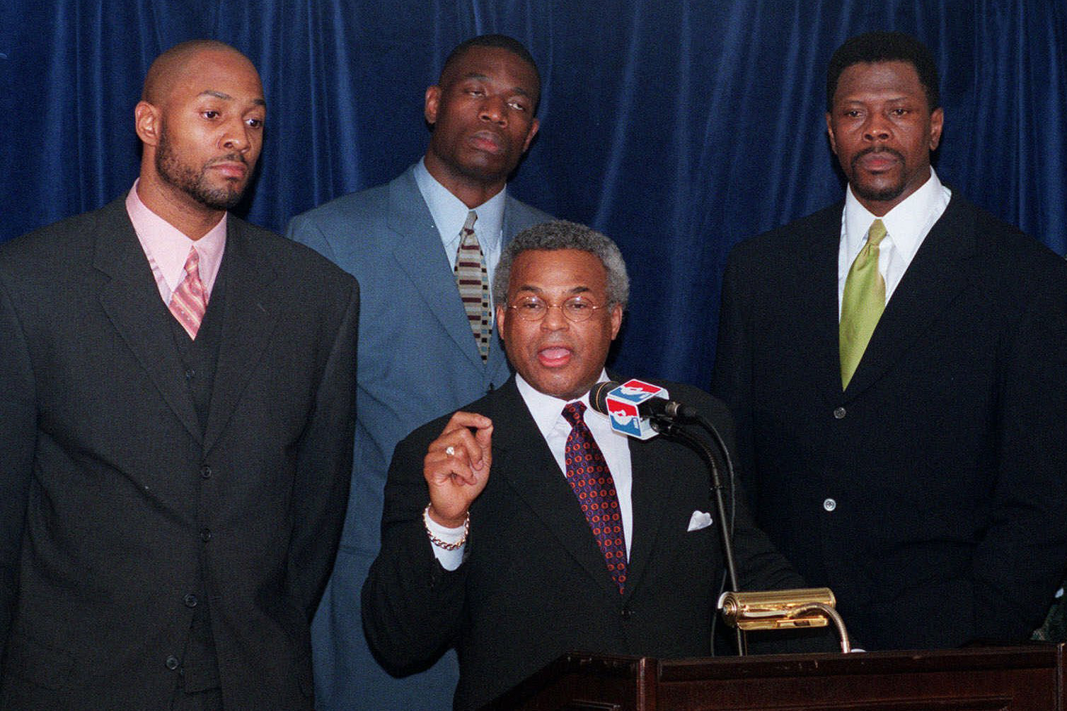 National Basketball Players Association leader Billy Hunter speaks to the media, backed up by Alonzo Mourning, left, Dikembe Mutombo, center left, Patrick Ewing, center right, and Danny Schayes, after negotiators failed to reach an agreement in the NBA lockout talks Thursday night, Dec. 3, 1998, in New York.