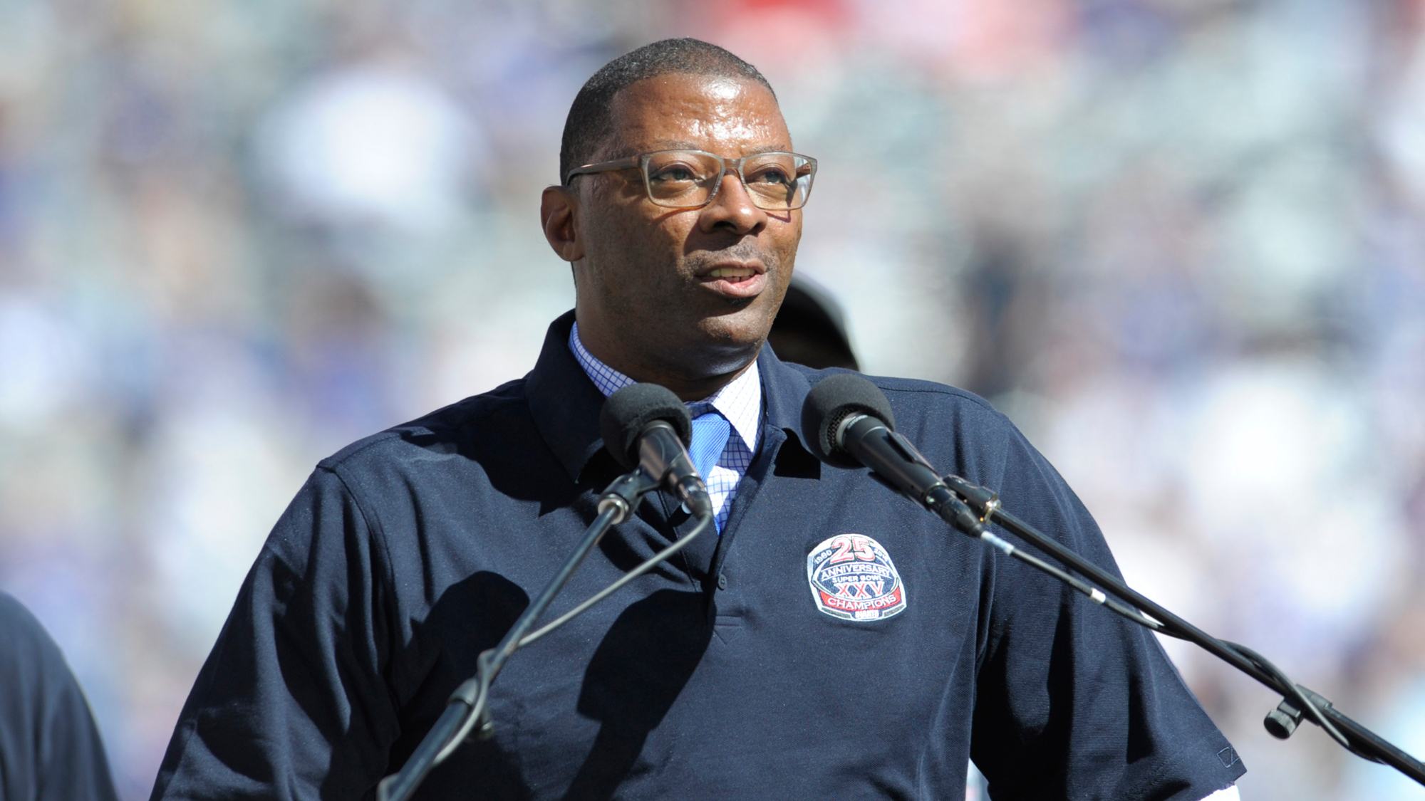 Former New York Giants' Carl Banks speaks to the fans during a 25 year anniversary celebration at halftime of an NFL football game against the Atlanta Falcons, Sunday, Sept. 20, 2015, in East Rutherford, N.J.