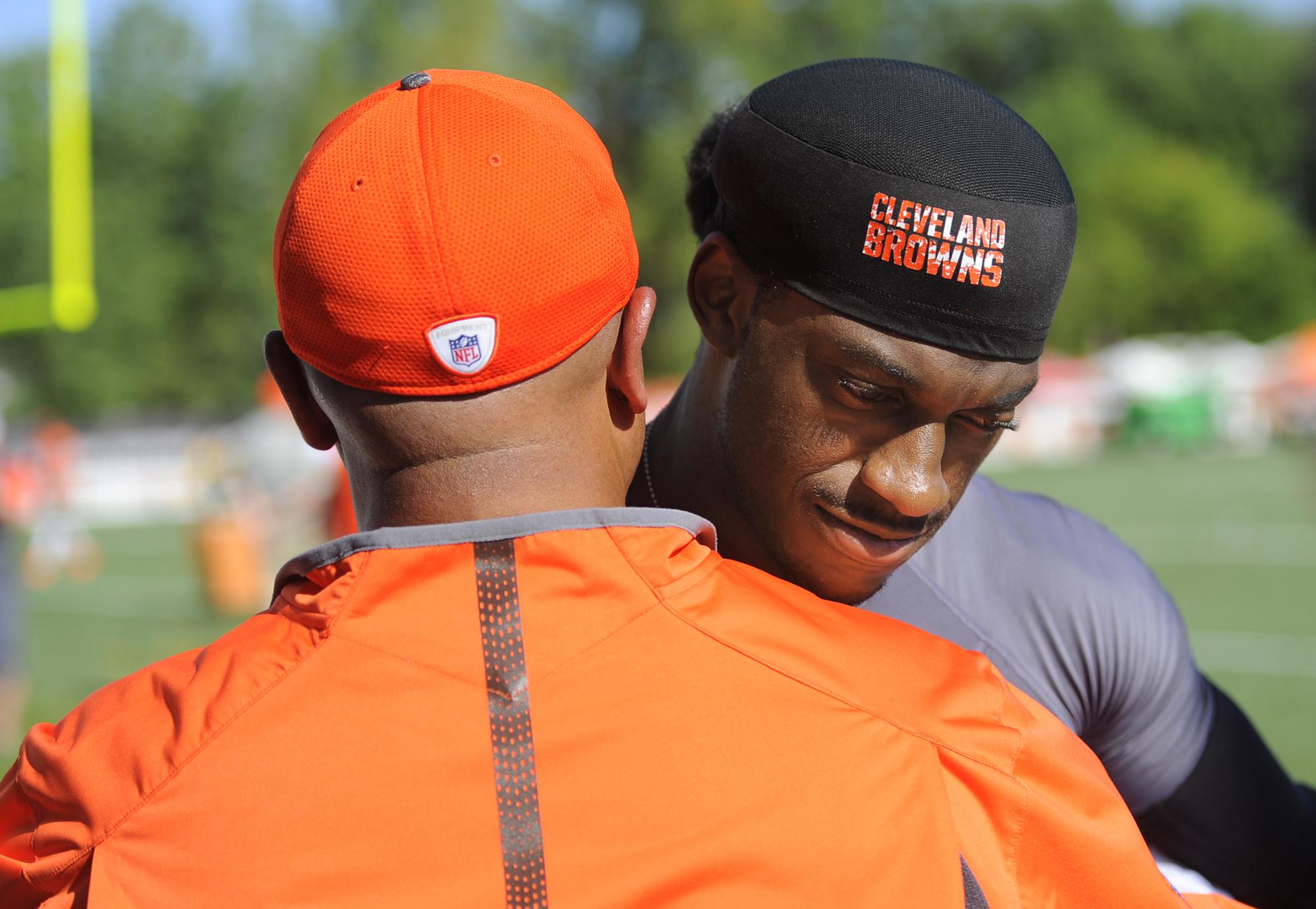 Cleveland Browns quarterback Robert Griffin III hugs head coach Hue Jackson after practice at the NFL football team's training camp Monday, Aug. 1, 2016, in Berea, Ohio.