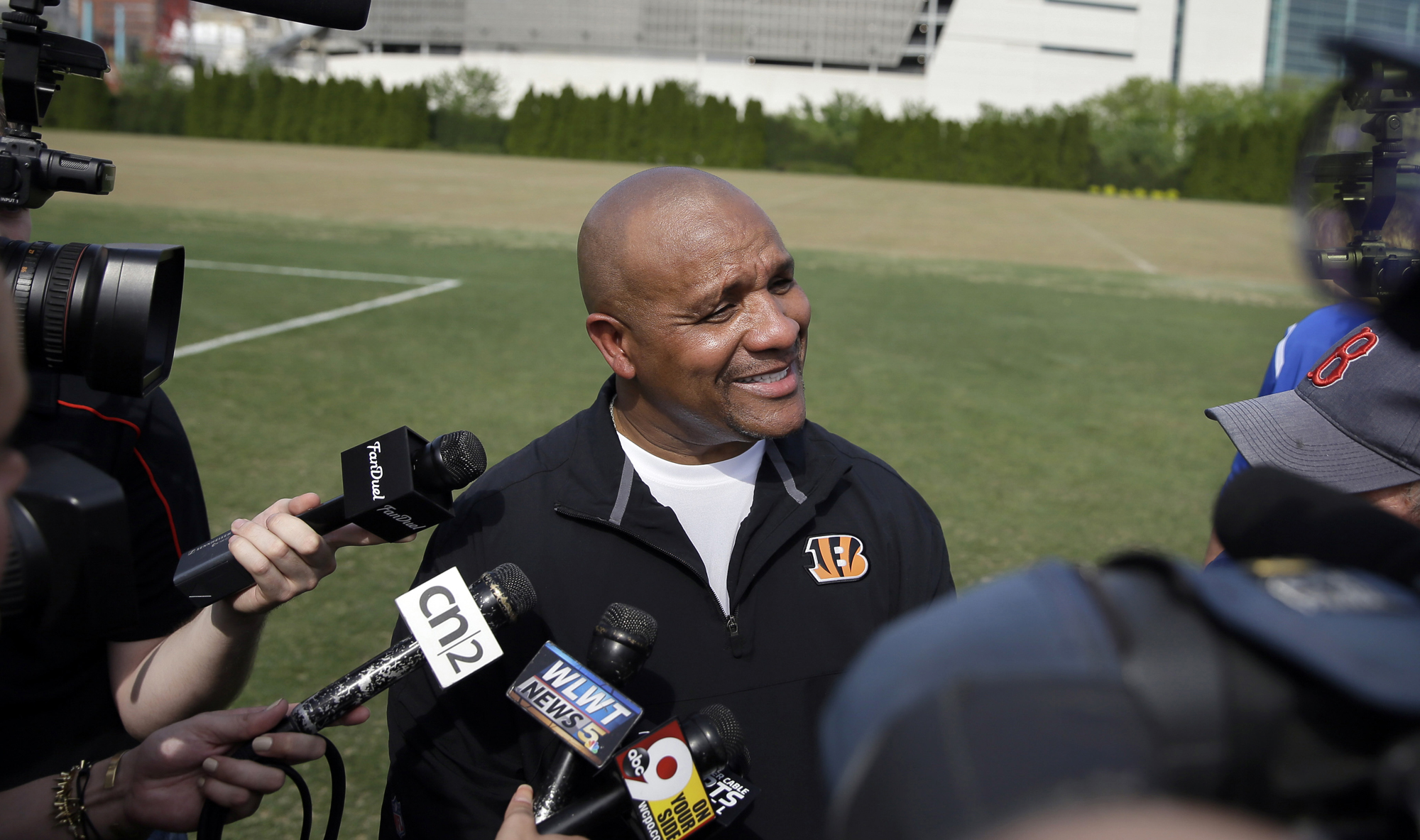 Cincinnati Bengals NFL football offensive coordinator Hue Jackson speaks to reporters outside Paul Brown Stadium following a rookie minicamp in Cincinnati. New Cleveland Browns coach Hue Jackson said the team is 'not anywhere close' to making a decision on it will use the No. 2 overall pick in this year's NFL draft.