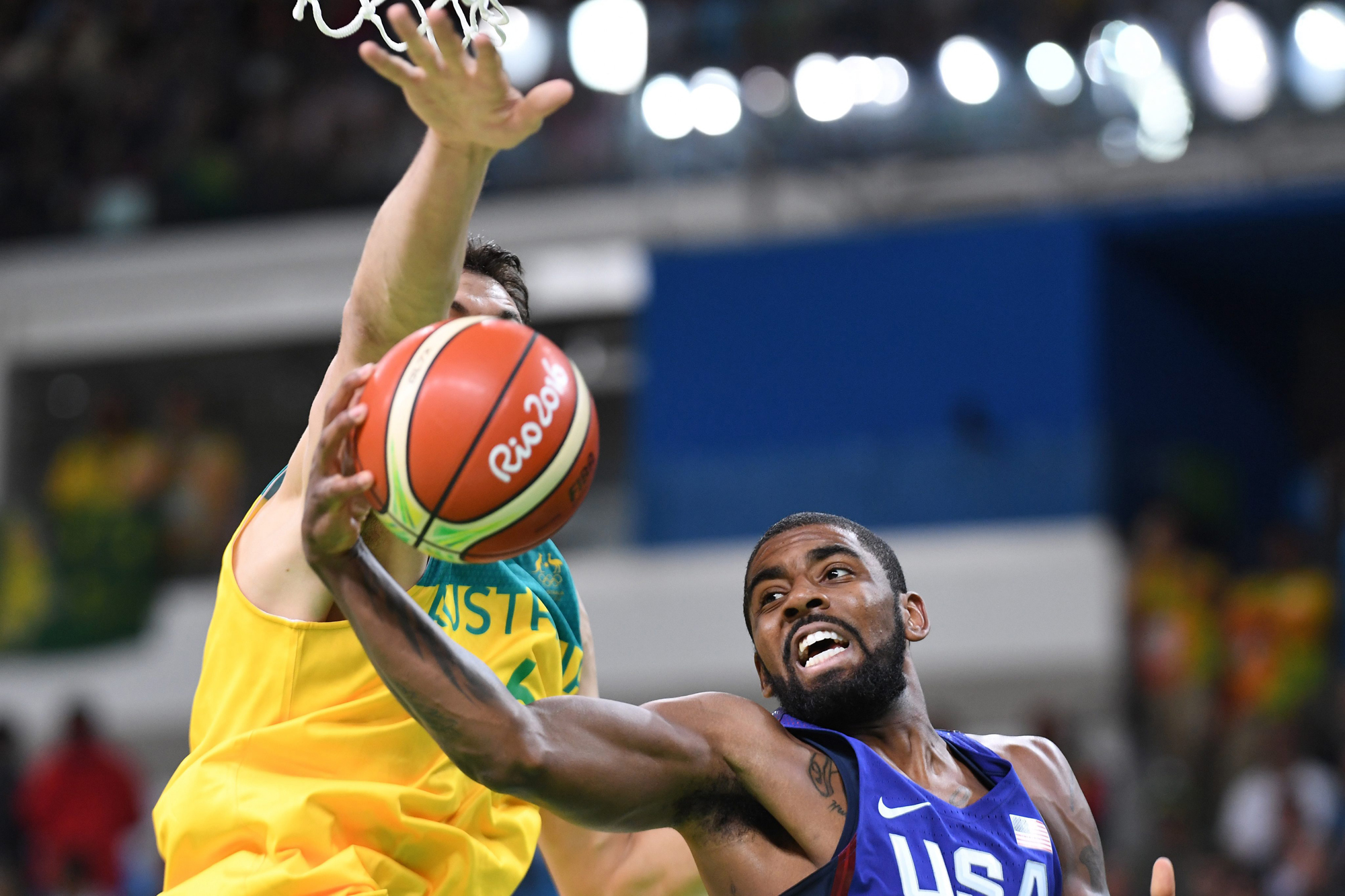 Australia's Andrew Bogut (L, obscured) tries to block USA's Kyrie Irving during their Men's Preliminary Round Group A match between Australia and the USA for the Rio 2016 Olympic Games at the Youth Arena in Rio de Janeiro, Brazil, 10 August 2016.