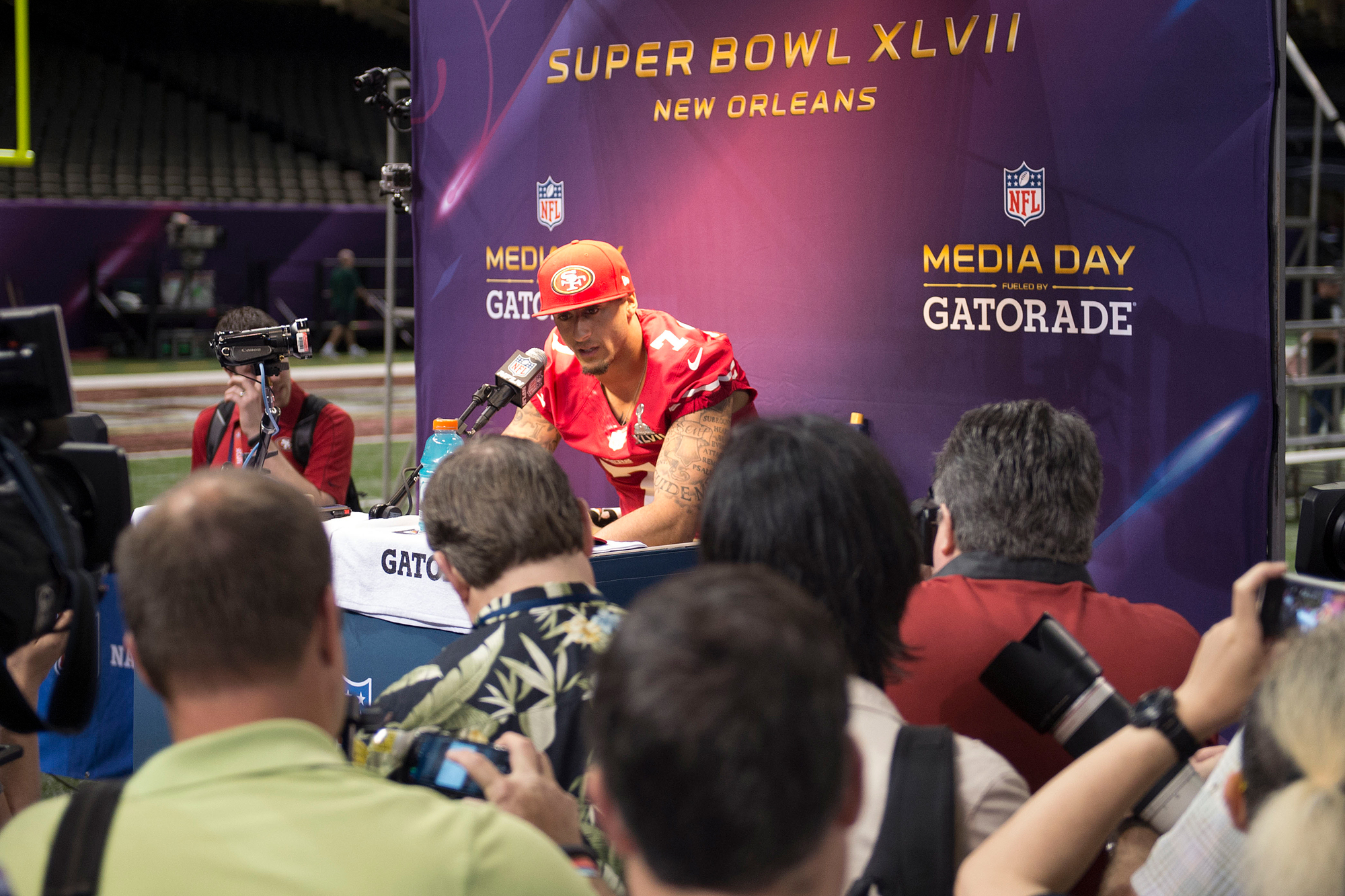 Quarterback Colin Kaepernick of the San Francisco 49ers answers questions during Super Bowl Media Day on Tuesday, January 29, 2013, in New Orleans, Louisiana.