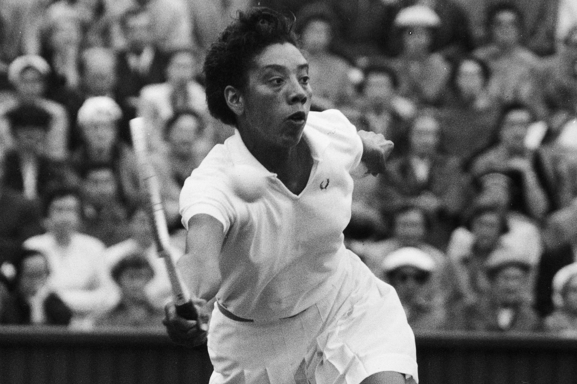 America's Althea Gibson in play against Shirley Fry on the centre court at Wimbledon, London, during the 1956 women's quarter finals.