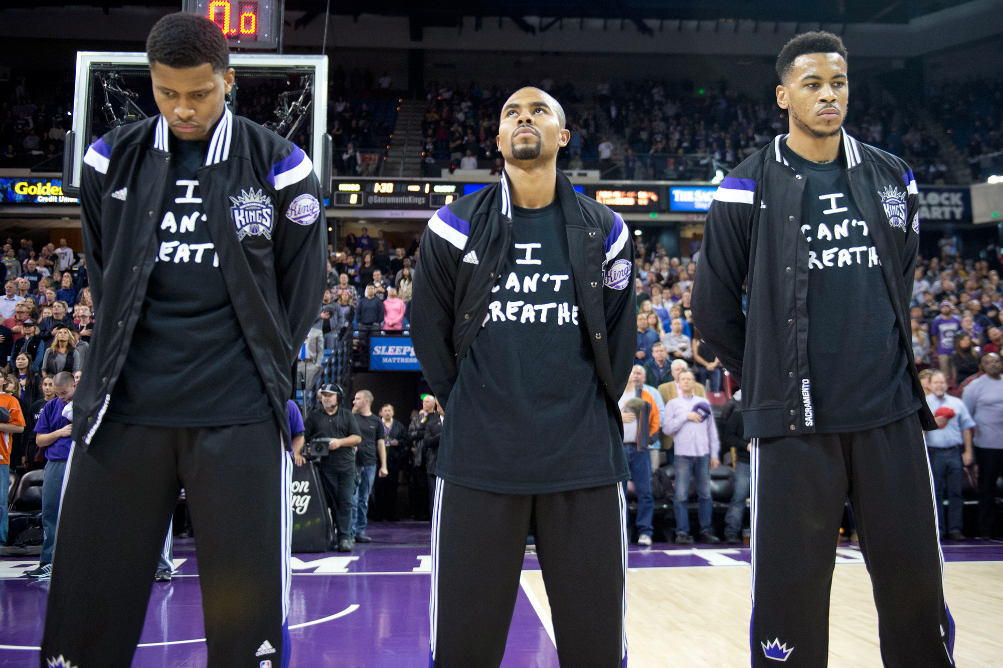 "The Sacramento Kings', from left, Rudy Gay, Ramon Sessions and Eric Moreland wear shirts that read ""I can't breathe"" in memory of Eric Garner during the national anthem before the game against the Houston Rockets on Thursday, Dec. 11, 2014, at Sleep Train Arena in Sacramento, Calif."