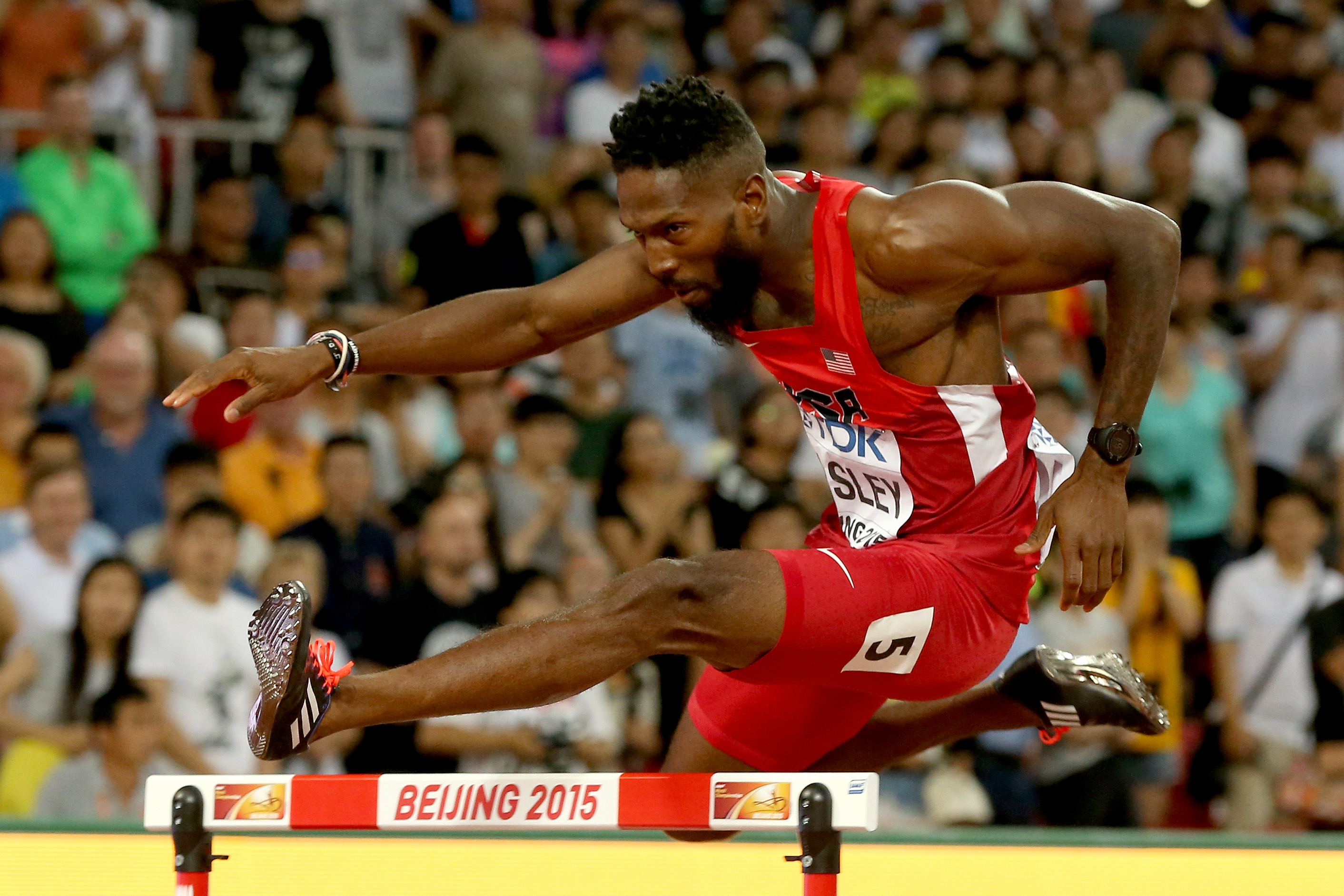 Michael Tinsley of the United States competes in the Men's 400 meters hurdles semi-final during day two of the 15th IAAF World Athletics Championships Beijing 2015 at Beijing National Stadium on August 23, 2015 in Beijing, China.
