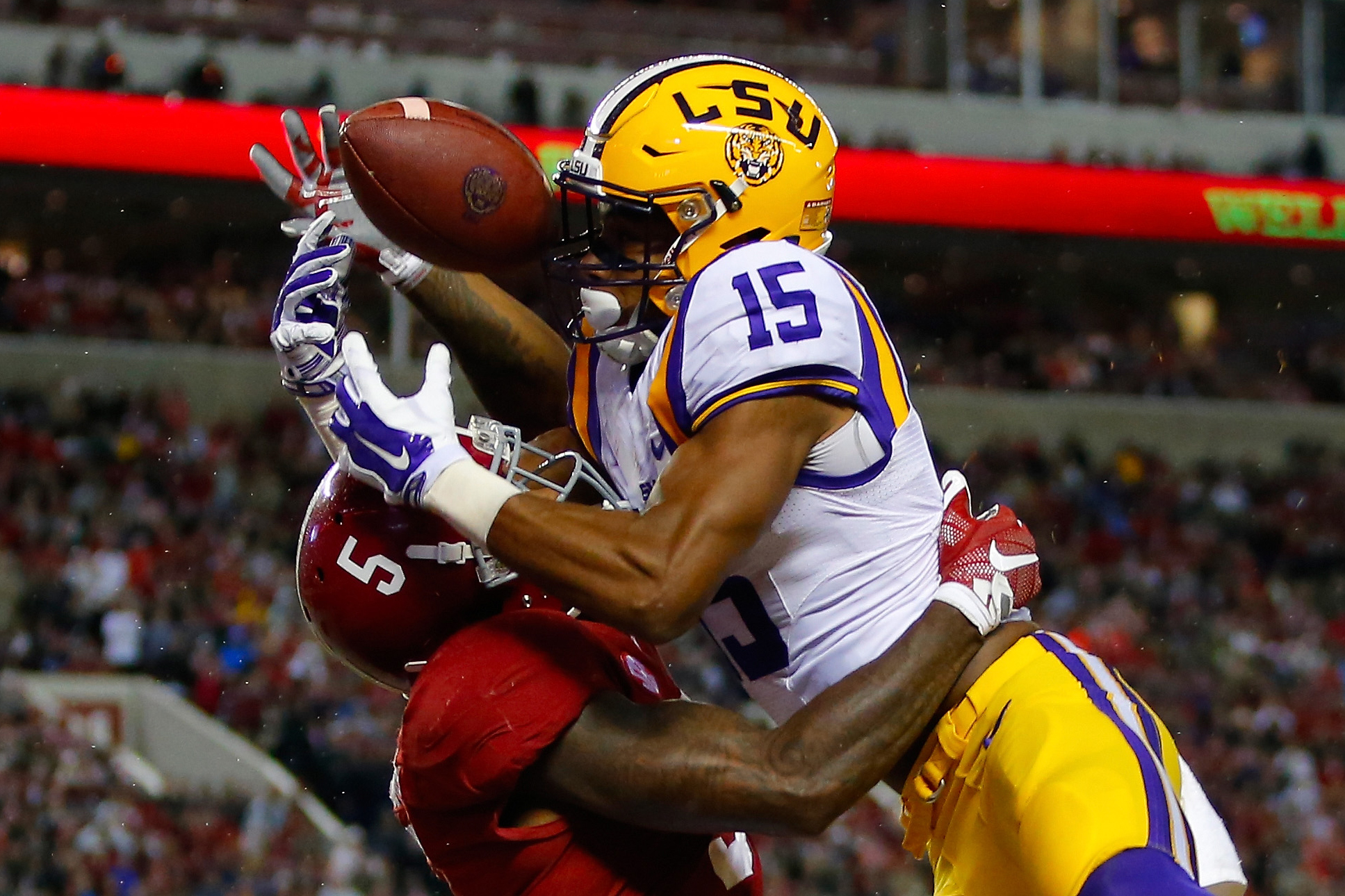 Malachi Dupre #15 of the LSU Tigers misses a touchdown interception due to pass interference on Cyrus Jones #5 of the Alabama Crimson Tide during the fourth quarter at Bryant-Denny Stadium on November 7, 2015 in Tuscaloosa, Alabama.