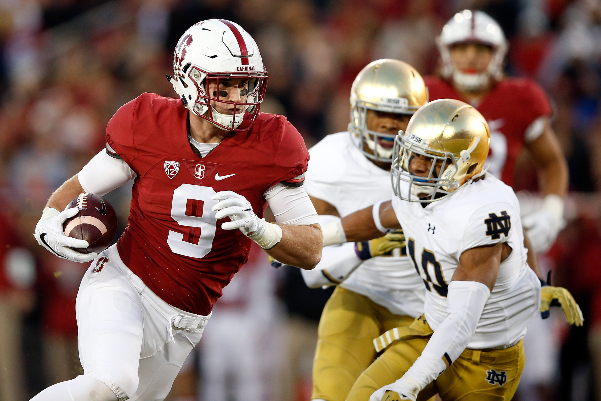 Dalton Schultz #9 of the Stanford Cardinal makes a reception during their game against the Notre Dame Fighting Irish at Stanford Stadium on November 28, 2015 in Palo Alto, California.