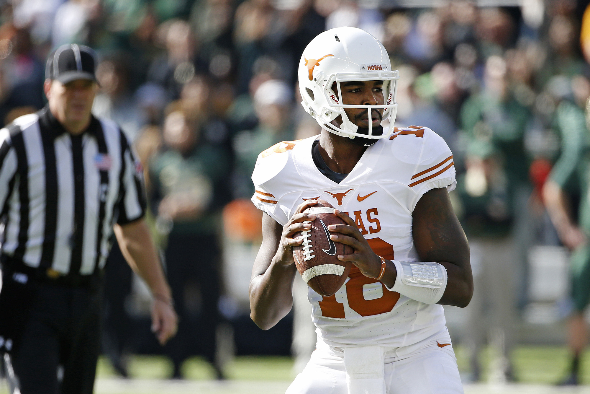 Tyrone Swoopes #18 of the Texas Longhorns looks for an open receiver against Shawn Oakman #2 of the Baylor Bears in the first quarter at McLane Stadium on December 5, 2015 in Waco, Texas.