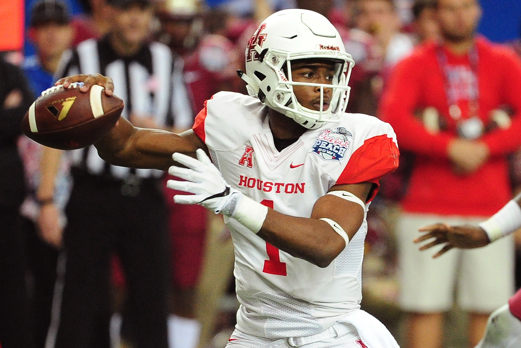 Greg Ward, Jr. #1 of the Houston Cougars passes against the Florida State Seminoles during the Chick-Fil-A Peach Bowl at the Georgia Dome on December 31, 2015 in Atlanta, Georgia.