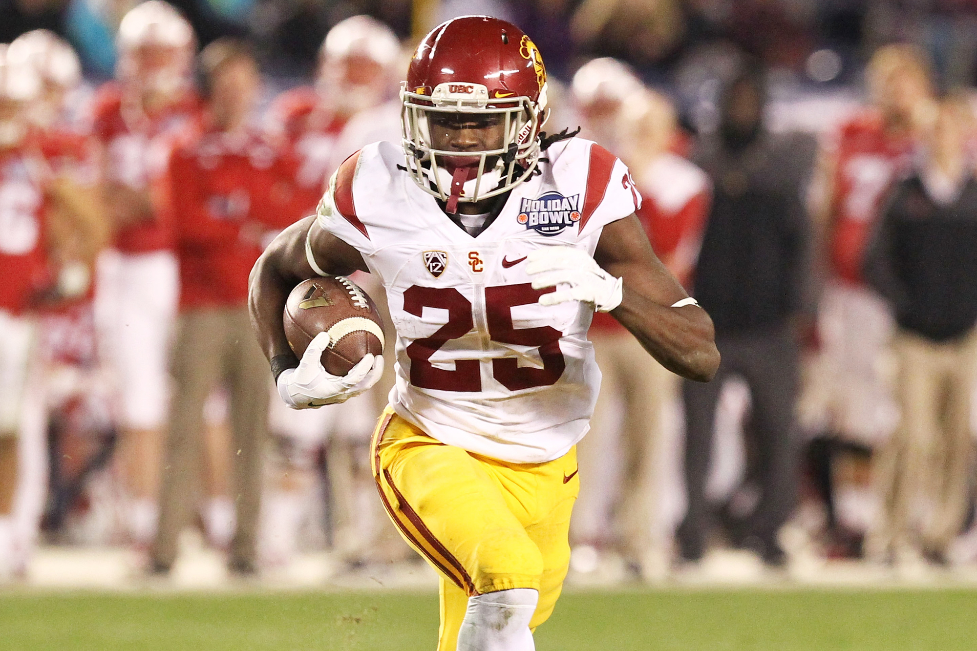 Ronald Jones II #25 of the USC Trojans carries the ball against the Wisconsin Badgers during the National University Holiday Bowl at Qualcomm Stadium on December 30, 2015 in San Diego, California.