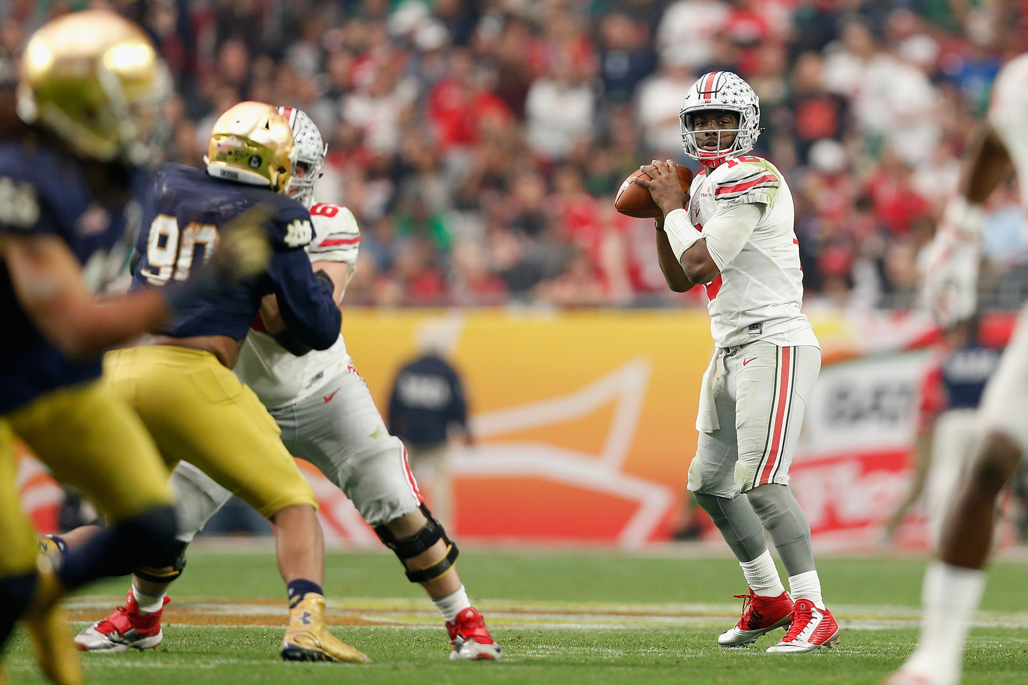 Quarterback J.T. Barrett #16 of the Ohio State Buckeyes drops back to pass during the BattleFrog Fiesta Bowl against the Notre Dame Fighting Irish at University of Phoenix Stadium on January 1, 2016 in Glendale, Arizona.