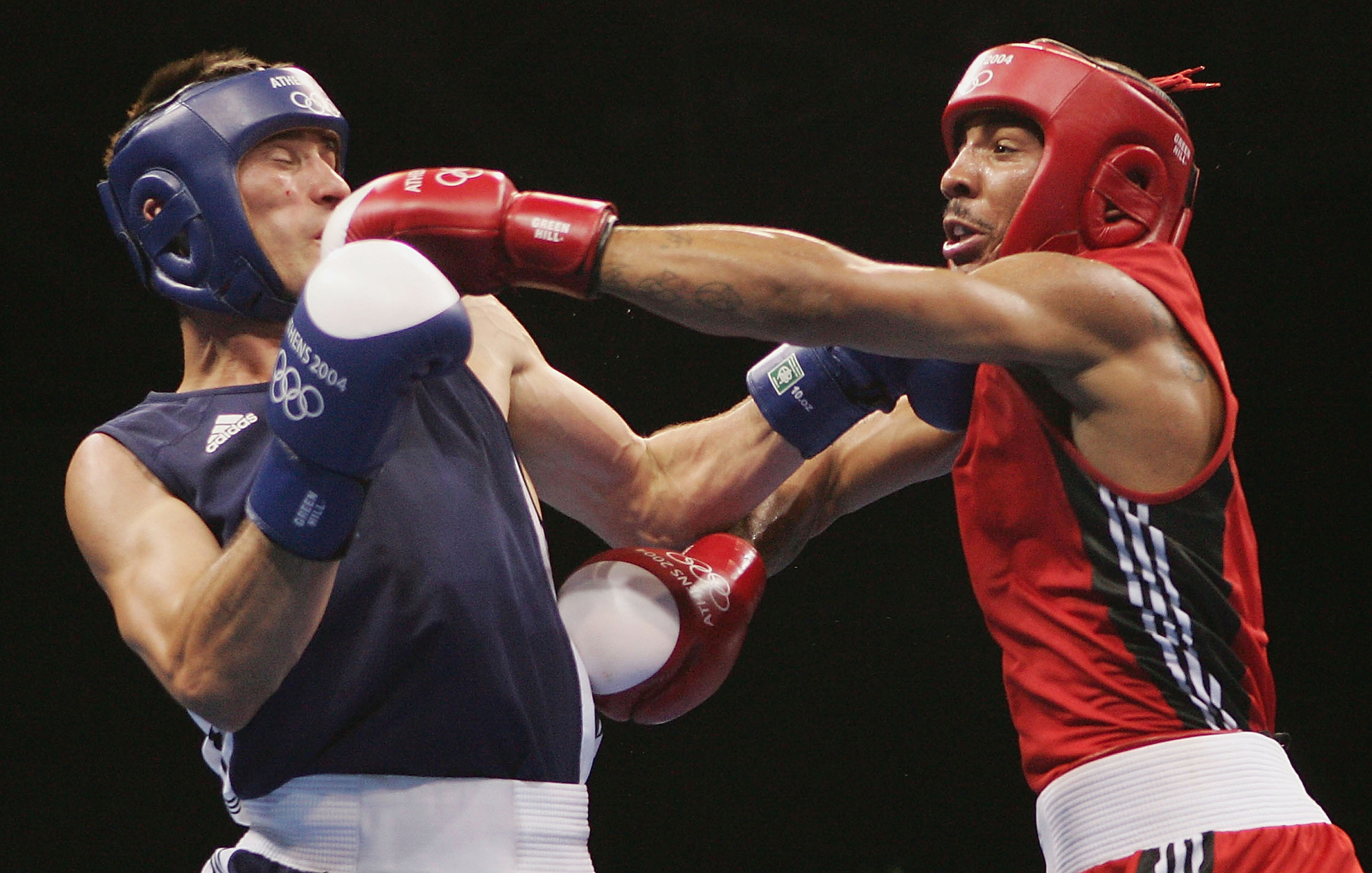 Andre Ward of the USA catches Magomed Aripgadjiev of Belarus (Blue) with a left during the men's boxing 81 kg final bout on August 29, 2004 during the Athens 2004 Summer Olympic Games at Peristeri Olympic Boxing Hall in Athens, Greece.
