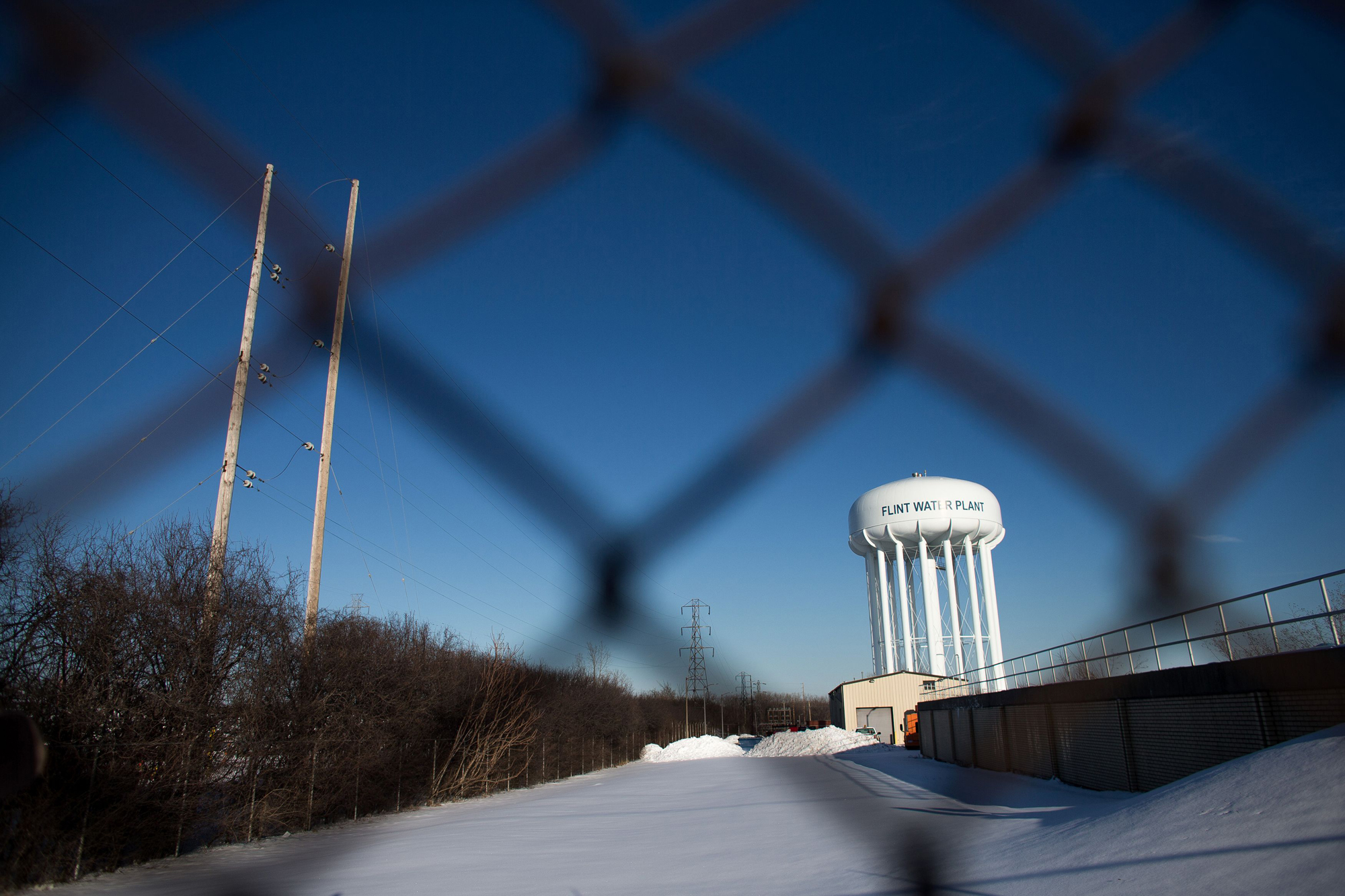 The water tower at the Flint Water Plant in Flint, Michigan, looms large over the city March 4, 2016 nearly 2 years after the start of the city's water crisis.