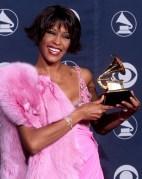 Pop diva Whitney Houston holds her Grammy award fo
