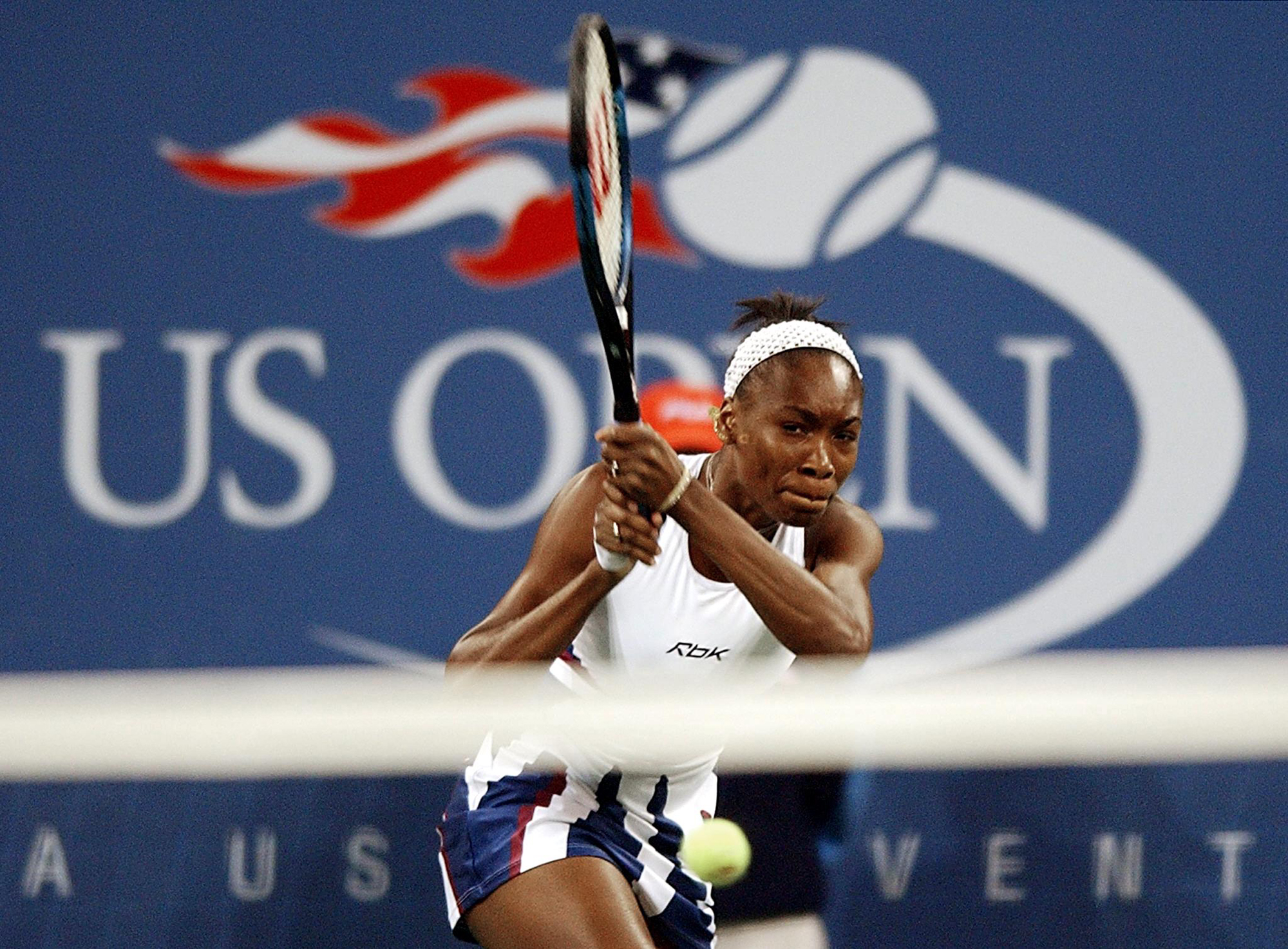 Venus Williams of the US hits a backhand to Serena Williams of the US during their women's final match at the US Open Tennis Tournament 07 September, 2002 at Flushing Meadows, NY. This is the fourth meeting of the Williams sisters in a grand-slam final.