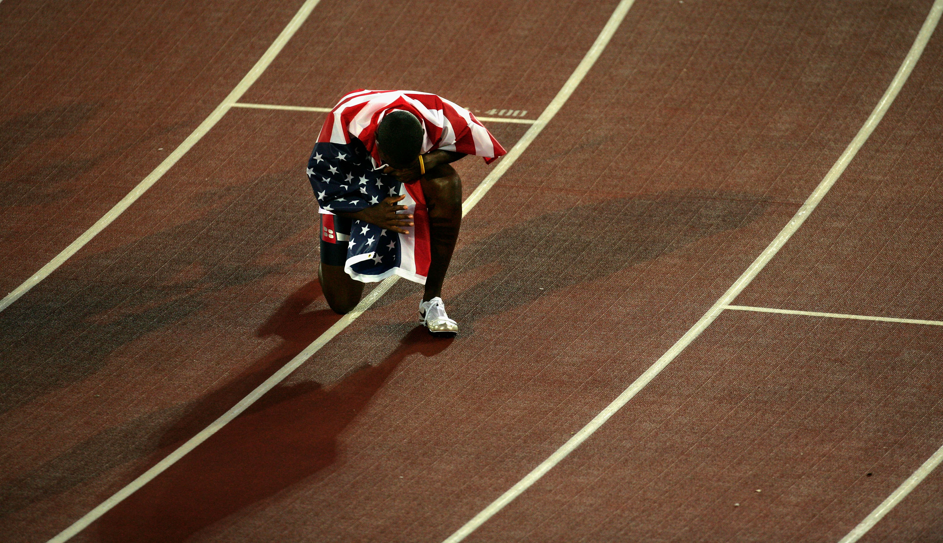 Justin Gatlin of USA celebrates after he won gold in the men's 100 Metres final at the 10th IAAF World Athletics Championships on August 7, 2005 in Helsinki, Finland.