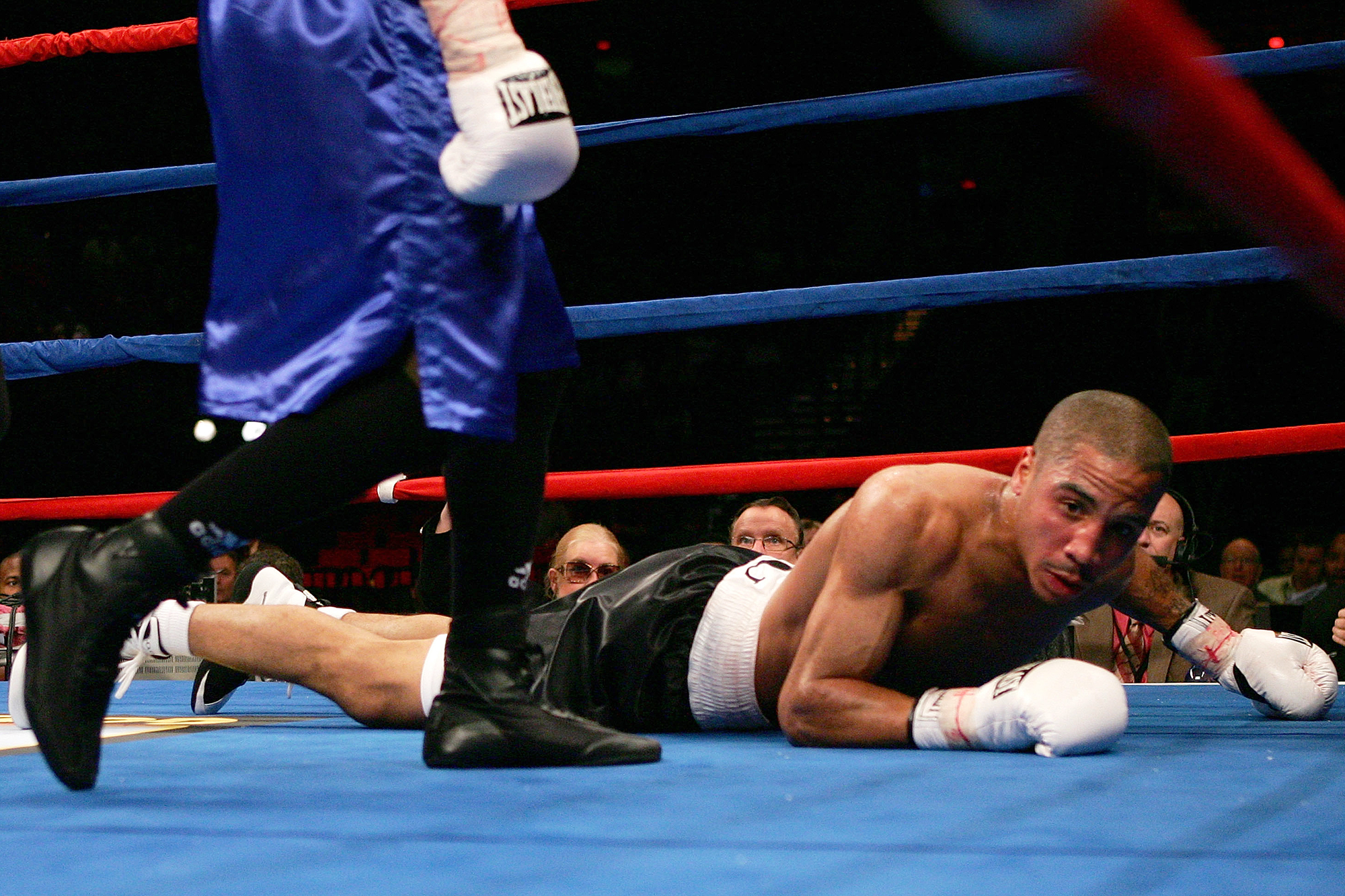 Andre Ward is knocked down in the fourth round by Darnell Boone during their middleweight fight on November 19, 2005 at the Rose Garden in Portland, Oregon.