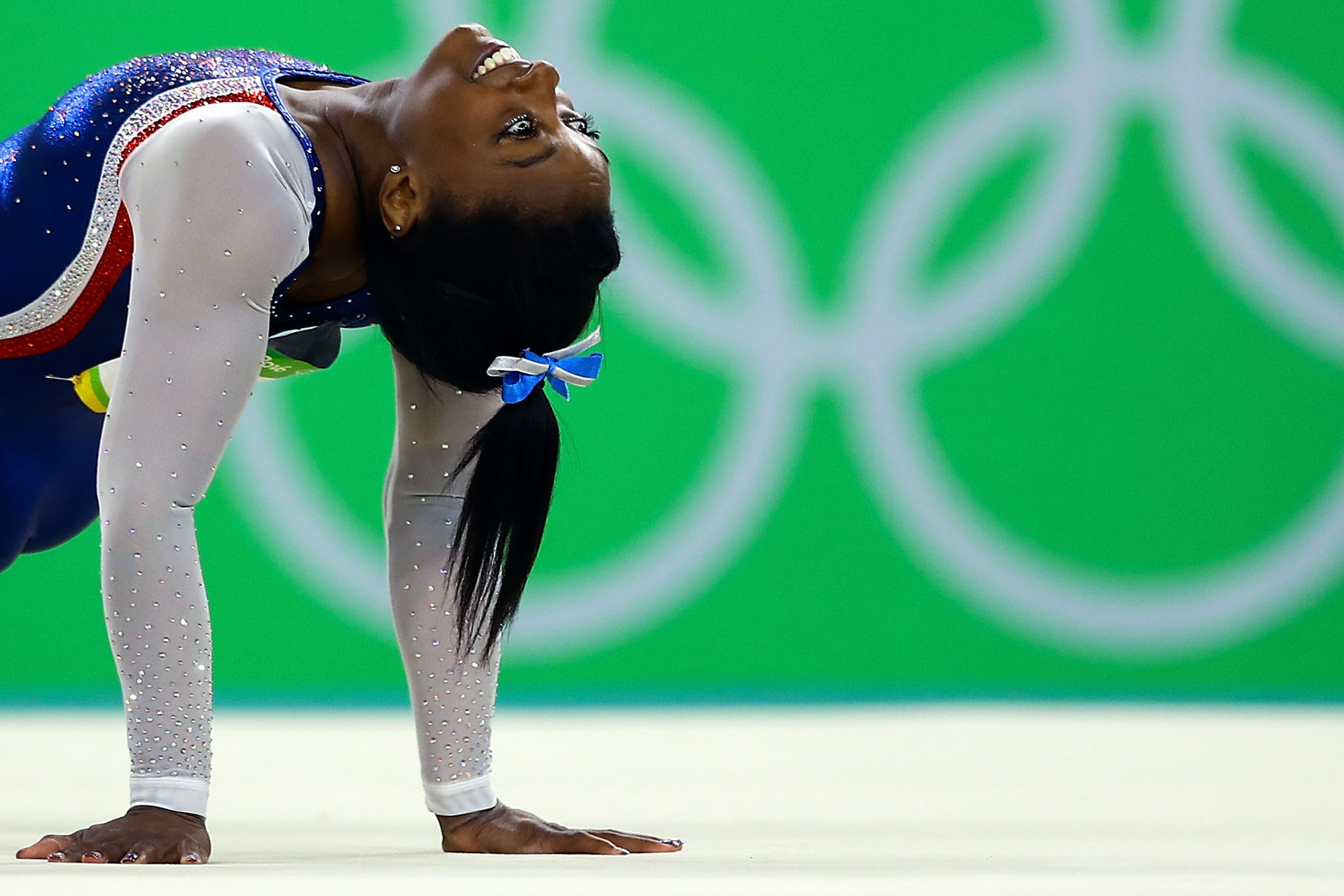 Simone Biles of the United States competes on the floor during the Women's Individual All Around Final on Day 6 of the 2016 Rio Olympics at Rio Olympic Arena on August 11, 2016 in Rio de Janeiro, Brazil.