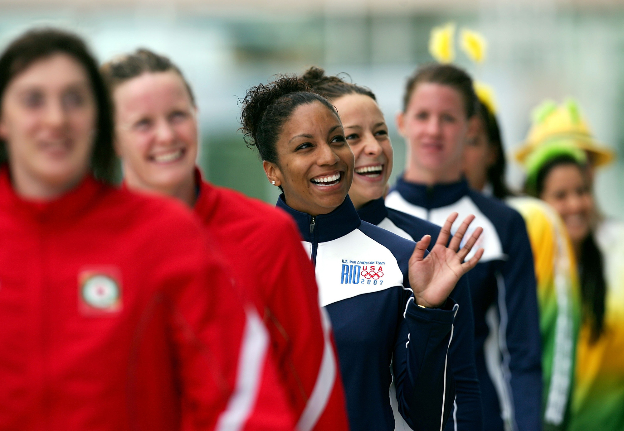 Maritza Correia of the United States of America smiles with her team after they received their gold medals in the 4x100m Freetstyle at the 2007 XV Pan American Games at the Maracana Stadium on July 19, 2007 in Rio de Janeiro, Brazil.