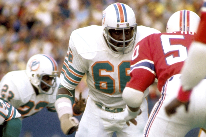Miami Dolphins Hall of Fame guard Larry Little sets to block a New England Patriots linebacker Sam Hunt in a 22-14 win on September 28, 1975 at Schaefer Stadium in Foxboro, Massachusetts.