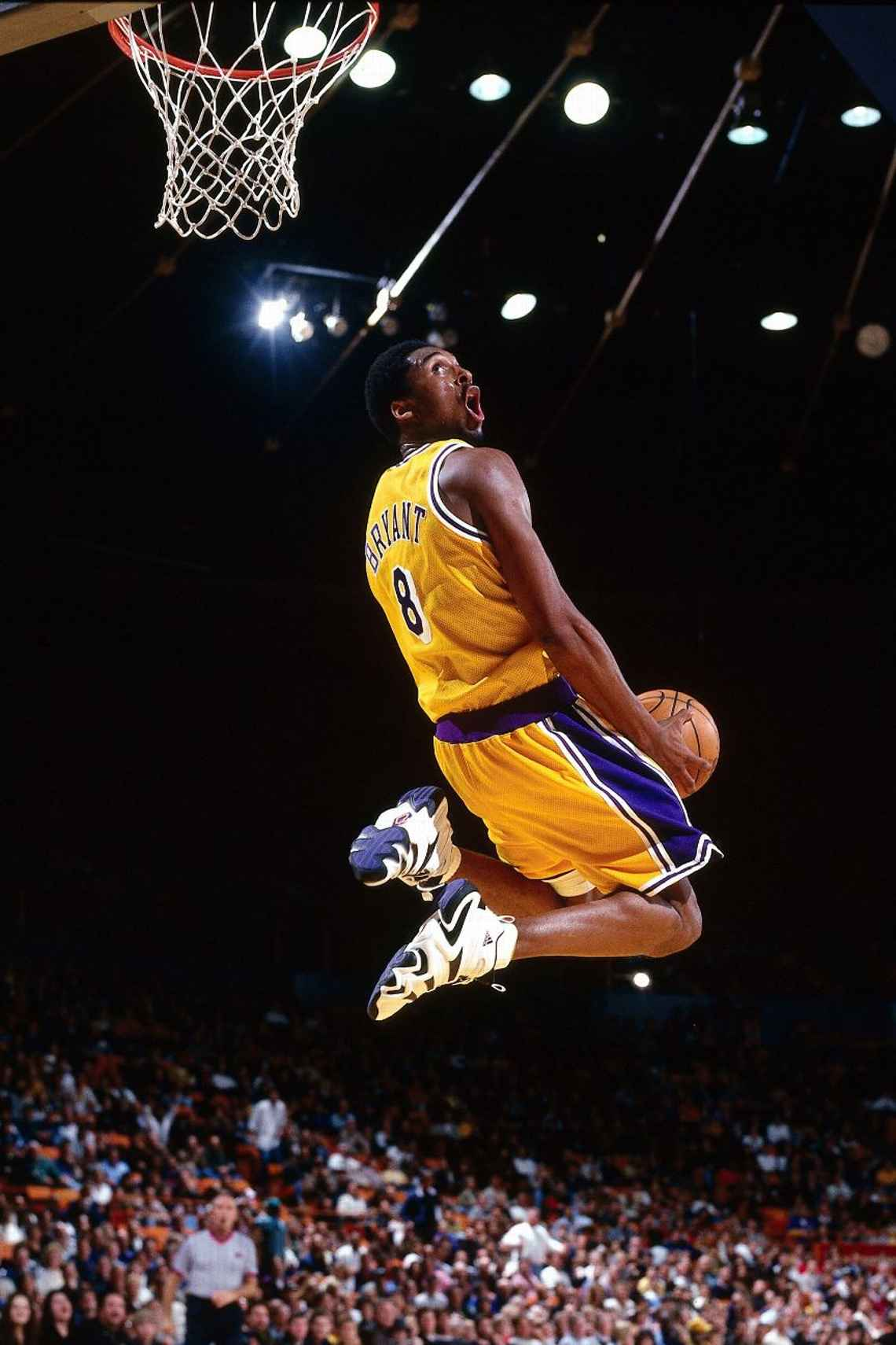 Kobe Bryant goes up for a reverse slam dunk against the Minnesota Timberwolves during at Staples Center in 1998.