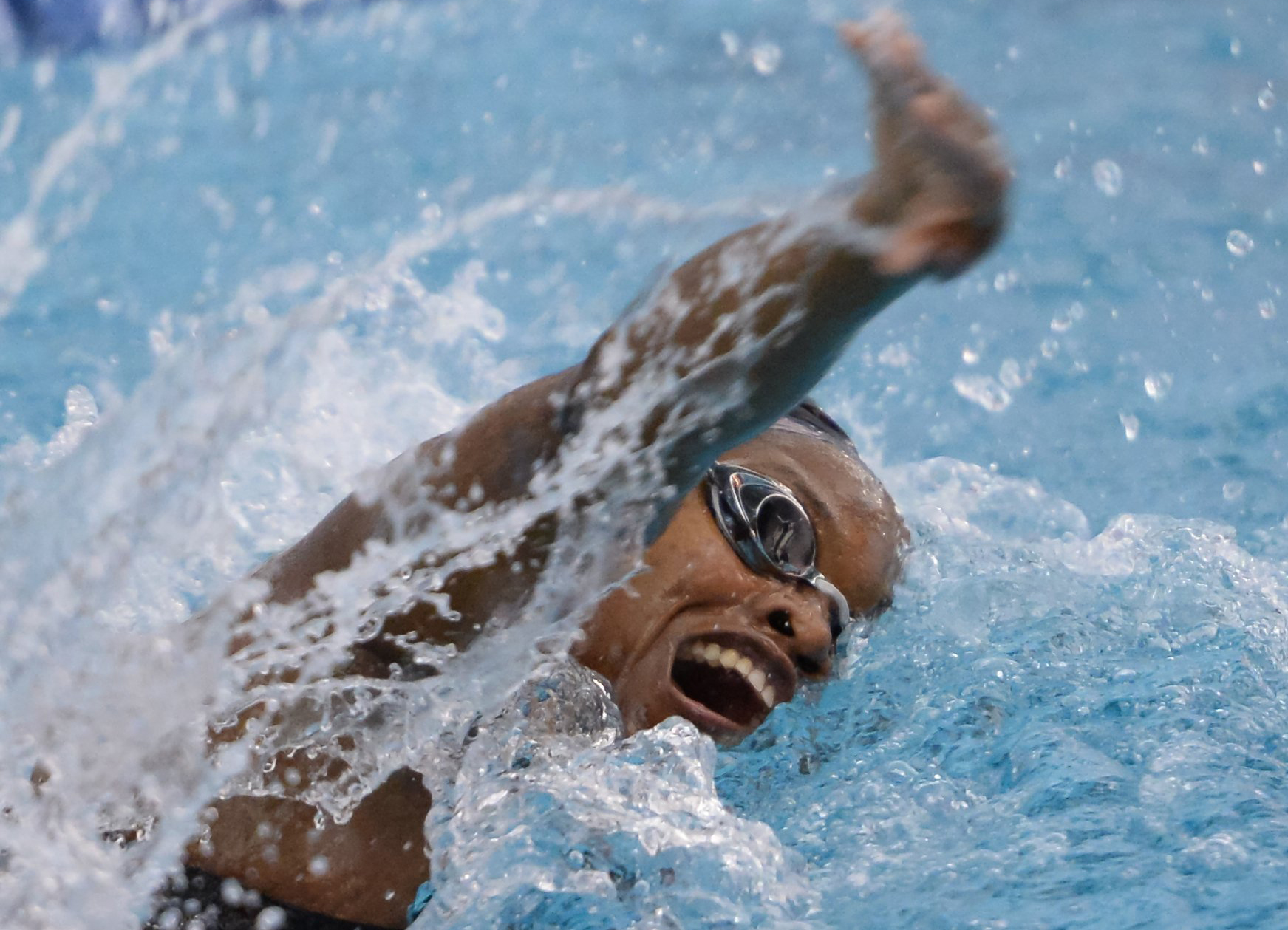Misha Neal of Durham School of the Arts swims in the Women's 100 Yard Freestyle race during the NCHSAA 1A/2A State Swimming Finals in Cary, N.C. on Friday, February 13, 2015.