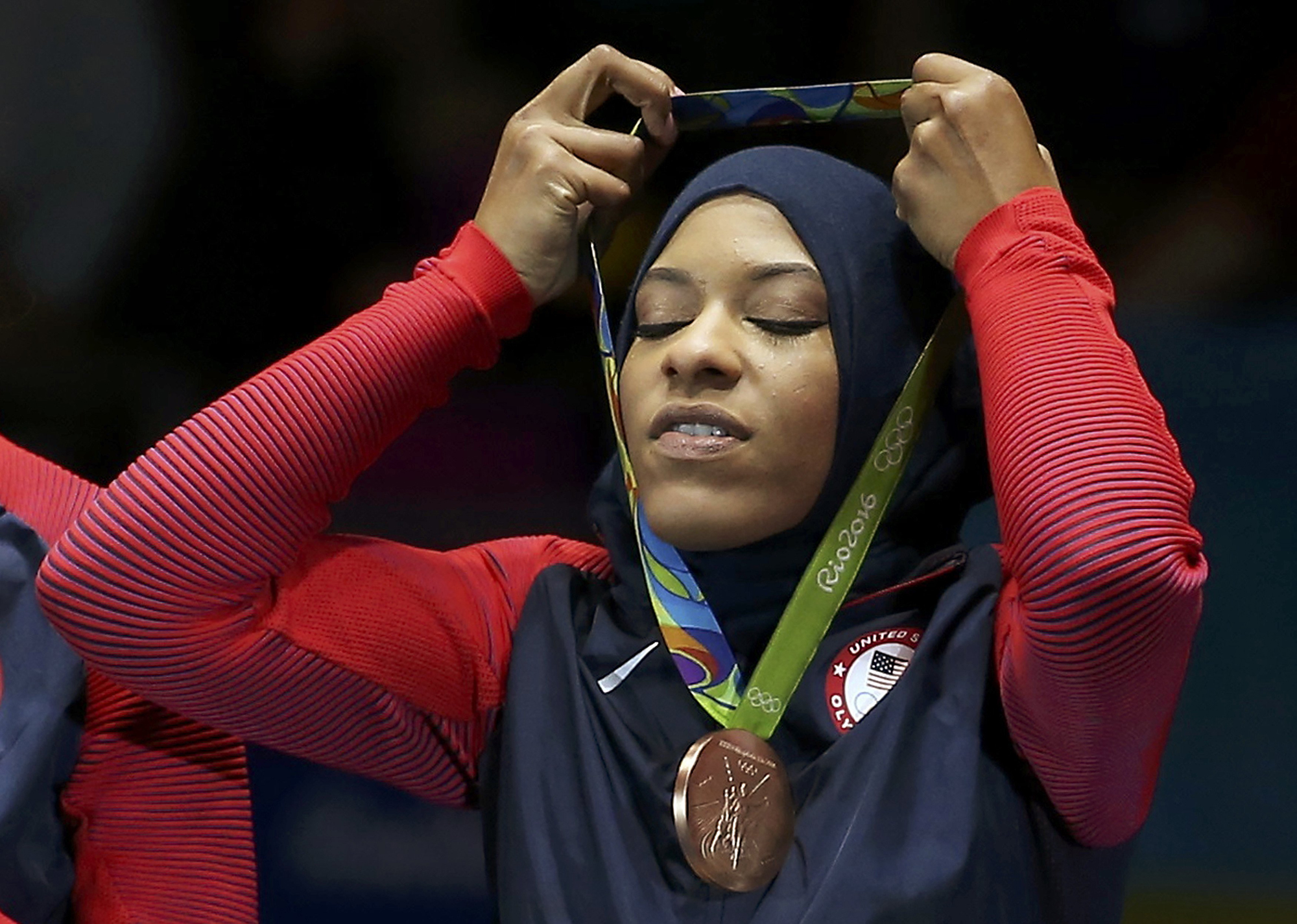 Ibtihaj Muhammad (USA) of USA celebrates winning the bronze medal.