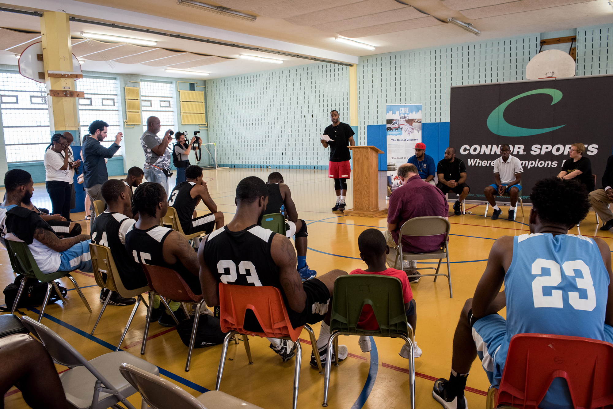NBA player Wayne Ellington Jr. of the Miami Heat, speaks during a panel about anti-gun violence to teams taking part in the first annual Philadelphia Peace Games tournament inside the Girard College Gymnasium in Philadelphia on Saturday, Aug. 20, 2016.