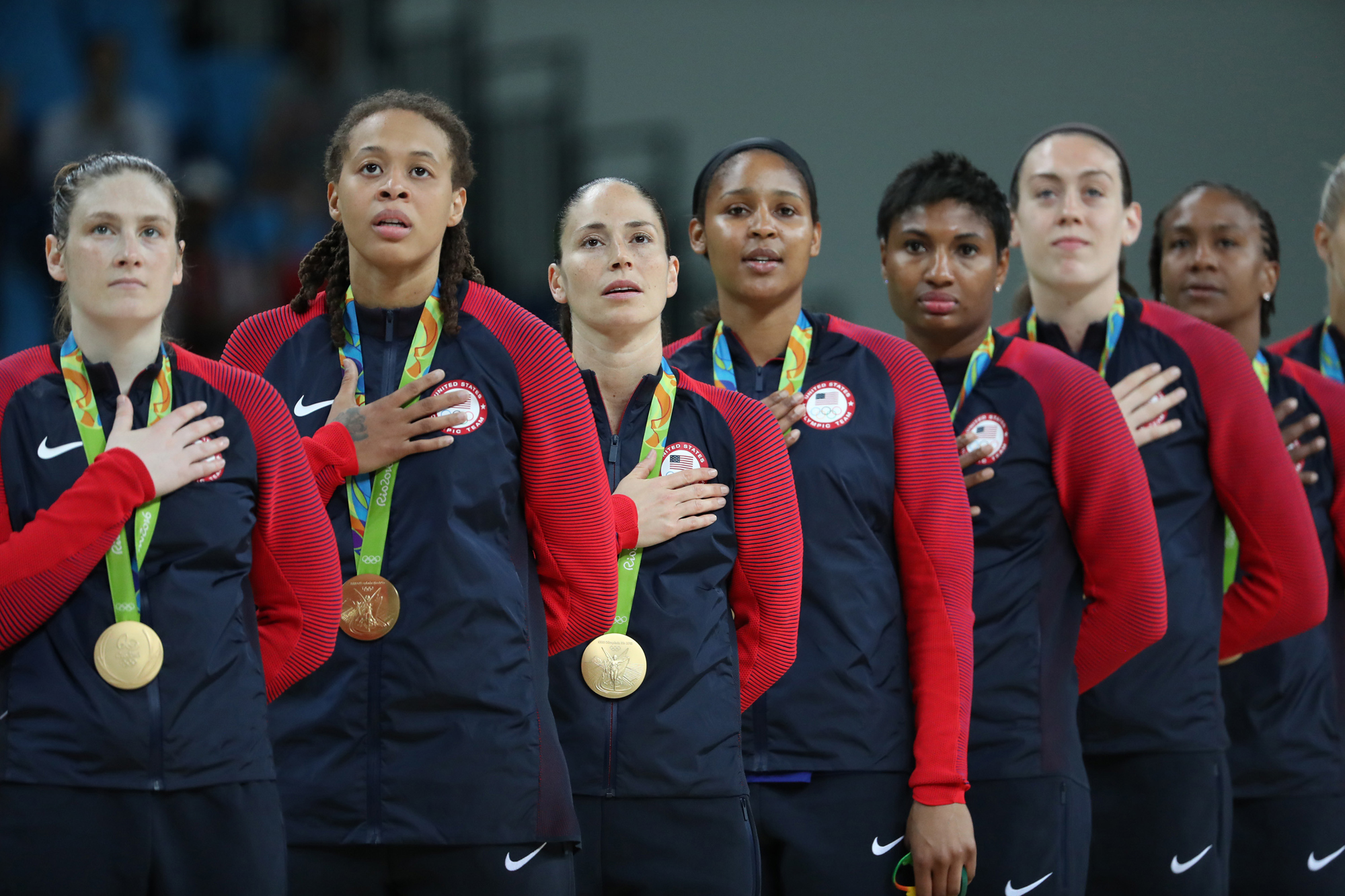 Players of the United States of America attend the awarding ceremony for the women's final of Basketball at the 2016 Rio Olympic Games in Rio de Janeiro, Brazil, on Aug. 20, 2016. The United States of America won the gold medal.