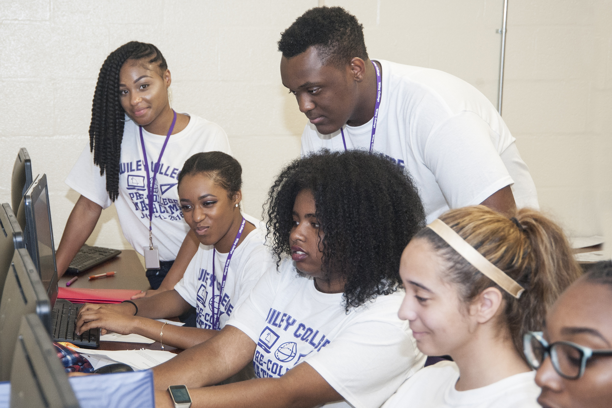 Students working on computers on the campus of Wiley College.