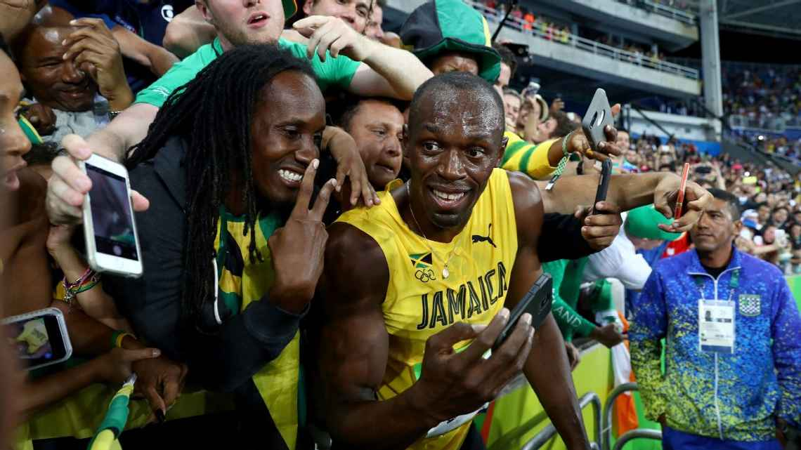 Usain Bolt saved the smiles and the memes for his postrace celebration in the arms of ecstatic Jamaican fans.