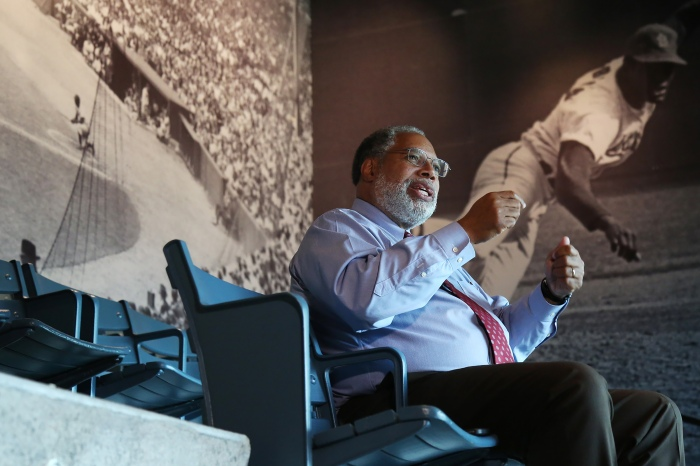 Director Lonnie Bunch speaks about raising money for the museum while sitting in stadium seats in the Sports Gallery Sept. 9, 2016.