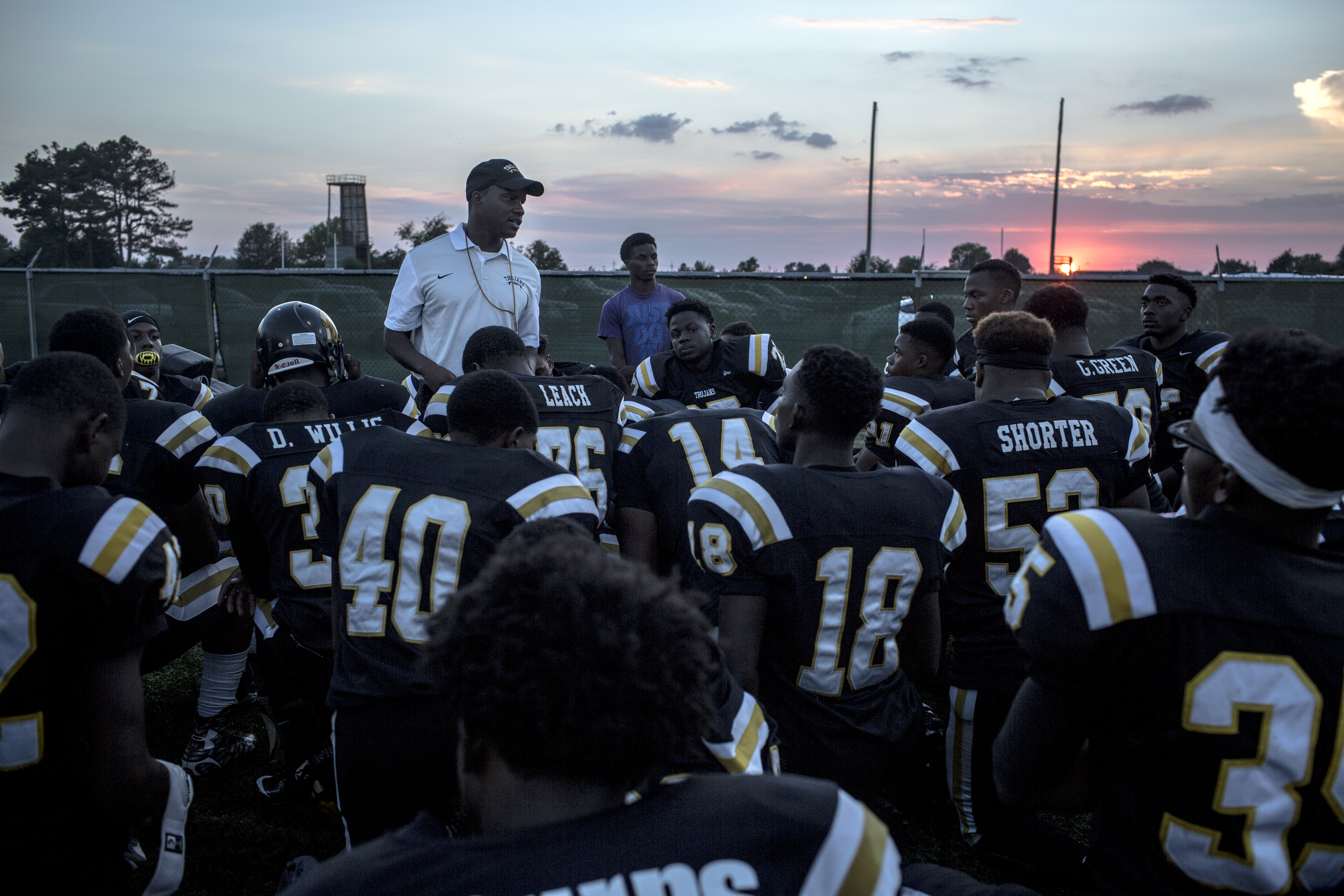 42bacd456 East Side coach Kendrick Woodard leads a prayer before his team s game  against crosstown rivals Cleveland High School.