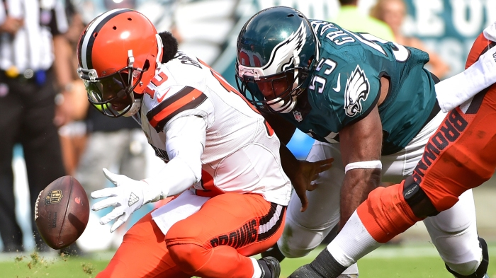 Sep 11, 2016; Philadelphia, PA, USA; Cleveland Browns quarterback Robert Griffin III (10) recovers his fumble after being stripped by Philadelphia Eagles defensive end Brandon Graham (55) during the fourth quarter at Lincoln Financial Field. The Eagles defeated the Browns, 29-10. Mandatory Credit: Eric Hartline-USA TODAY Sports